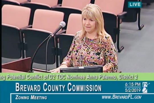 Brevard County Tourist Development Council member Anna Palermo,  an account executive with the media company Spectrum Reach, explains to the County Commission that she no longer will be involved with Spectum's account with the Office of Tourism.