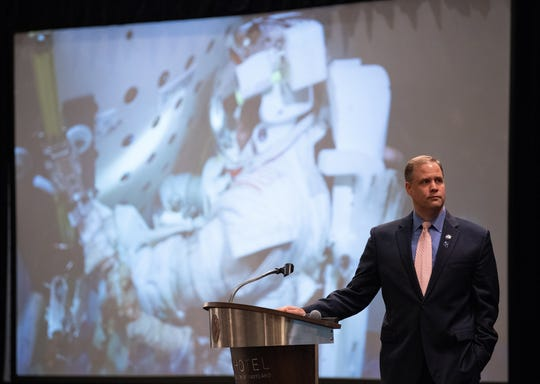 NASA Administrator Jim Bridenstine watches a short video as part of his keynote speech at the sixth International Academy of Astronautics Planetary Defense Conference, Monday, April 29, 2019, at The Hotel at the University of Maryland in College Park Maryland. The conference brings together experts from around the world to present the latest research on Near-Earth Objects and will highlight the development of the first-ever mission to demonstrate an asteroid defection technique for planetary defense, NASA's Double Asteroid Redirection Test (DART).