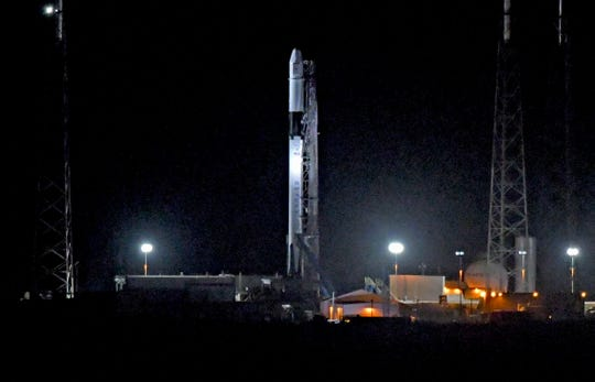 A SpaceX Falcon 9 rocket and Dragon cargo craft on the pad at Cape Canaveral Air Force Station's Launch Complex 40 before Friday's early morning attempt to launch the CRS-17 resupply mission for NASA was scrubbed due to an electrical problem with the rocket's landing drone ship and a reported helium leak.