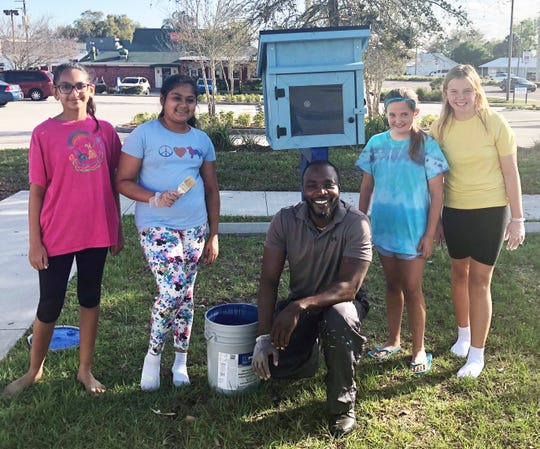 Students from Freedom 7 Elementary helped paint a Little Free Library as partners with United Way.