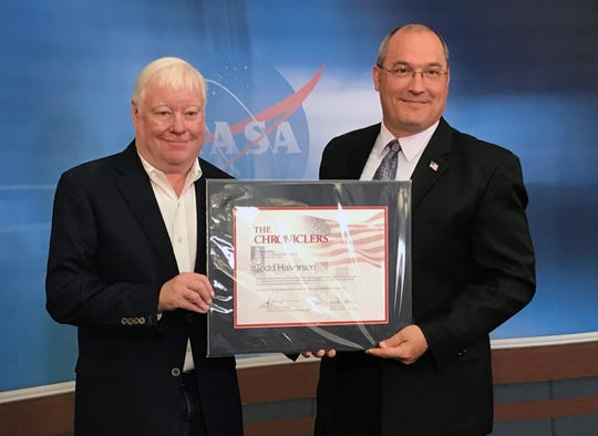 "Former FLORIDA TODAY space reporter Todd Halvorson, left, had his name added to NASA's ""Chroniclers,"" a list of retired journalists, broadcasters, authors and public relations representatives who have excelled at telling the story of America's evolving space program. Presenting the award is Greg Harland, acting news chief at KSC."