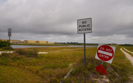 """No Public Access"" signs mark the northern terminus of Lake Andrew Drive in Viera."