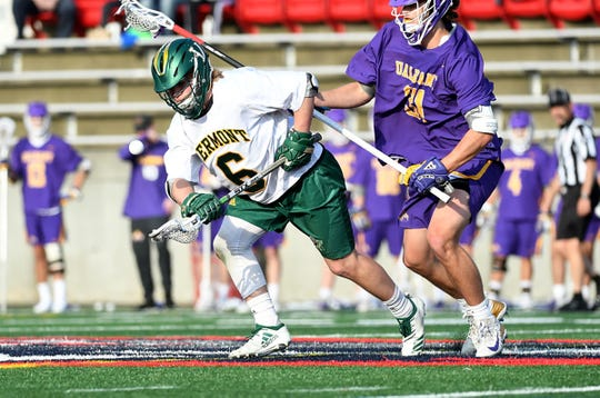 Vermont's Alex Semler scoops up a ground ball against Albany during Thursday's America East men's lacrosse semifinal in Stony Brook, New York. UVM won 13-9.