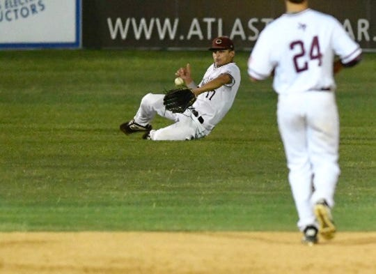Calallen outfield Matt Castro slides to make a catch against Carroll during Game 1 of a bi-district baseball series at Steve Chapman Field on Thursday, May 2, 2019.