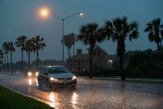 Drivers try to navigate slick roads in Corpus Christi as storms dump rain and bring high winds to the area on Friday, May 3, 2019.