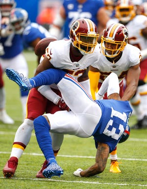 Washington Redskins linebacker Zach Brown (53) and cornerback Josh Norman (24) break up a pass to New York Giants wide receiver Odell Beckham Jr. (13) during a game from last season. Brown signed with the Eagles on Friday.