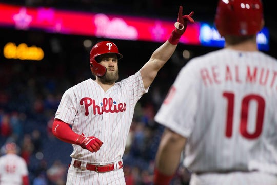 Apr 26, 2019; Philadelphia, PA, USA; Philadelphia Phillies right fielder Bryce Harper (3) reacts to his two RBI home run during the eighth inning against the Miami Marlins at Citizens Bank Park. Mandatory Credit: Bill Streicher-USA TODAY Sports