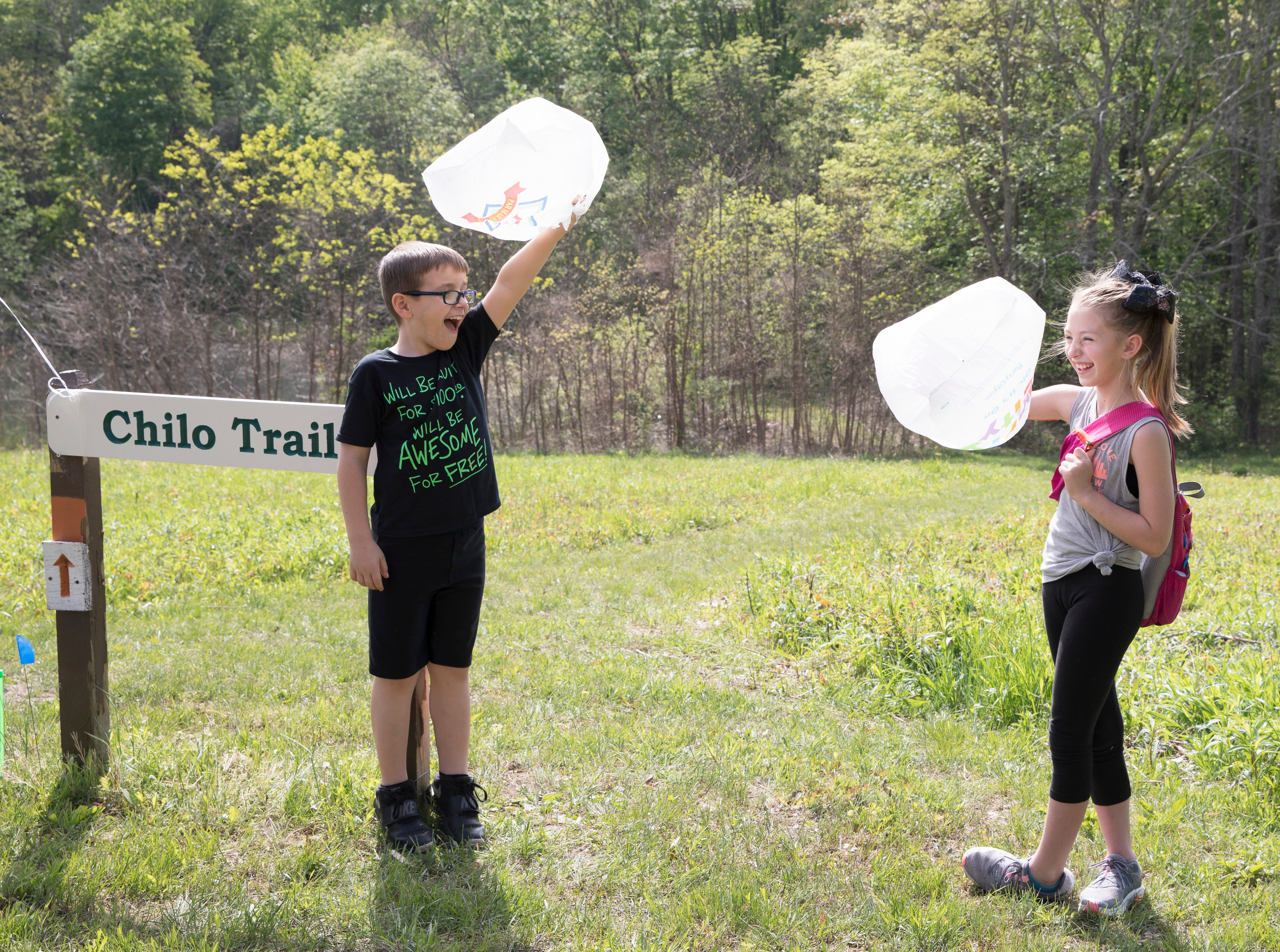 Owen Stotridge, left, and Makenna Fox hold up plastic bags as the strong wind makes them move violently during an interactive project at Buzzards Roost Nature Preserve  involving wind as part of STEM based learning at Chillicothe Primary School on Wednesday, May 1, 2019.