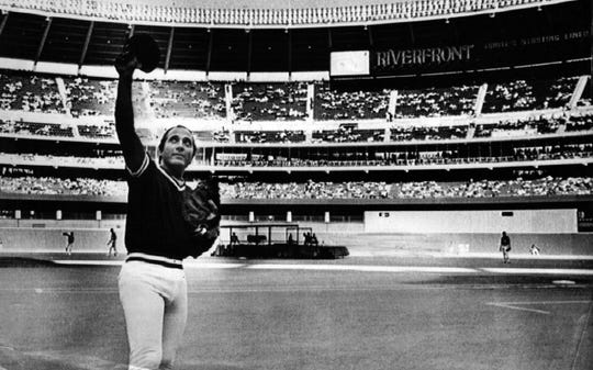 """SEPTEMBER 17, 1983: Cincinnati Reds catcher Johnny Bench waves to the crowd on Sept. 17, 1983, before the game against Houston in Riverfront Stadium. The night was designated """"Johnny Bench Night"""" to honor him as before he retired."""