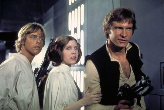 Mark Hamill as Luke Skywalker, Carrie Fisher as Princess Leia Organa and Harrison Ford as Han Solo in a scene from the motion picture Star Wars Episode IV - A New Hope.