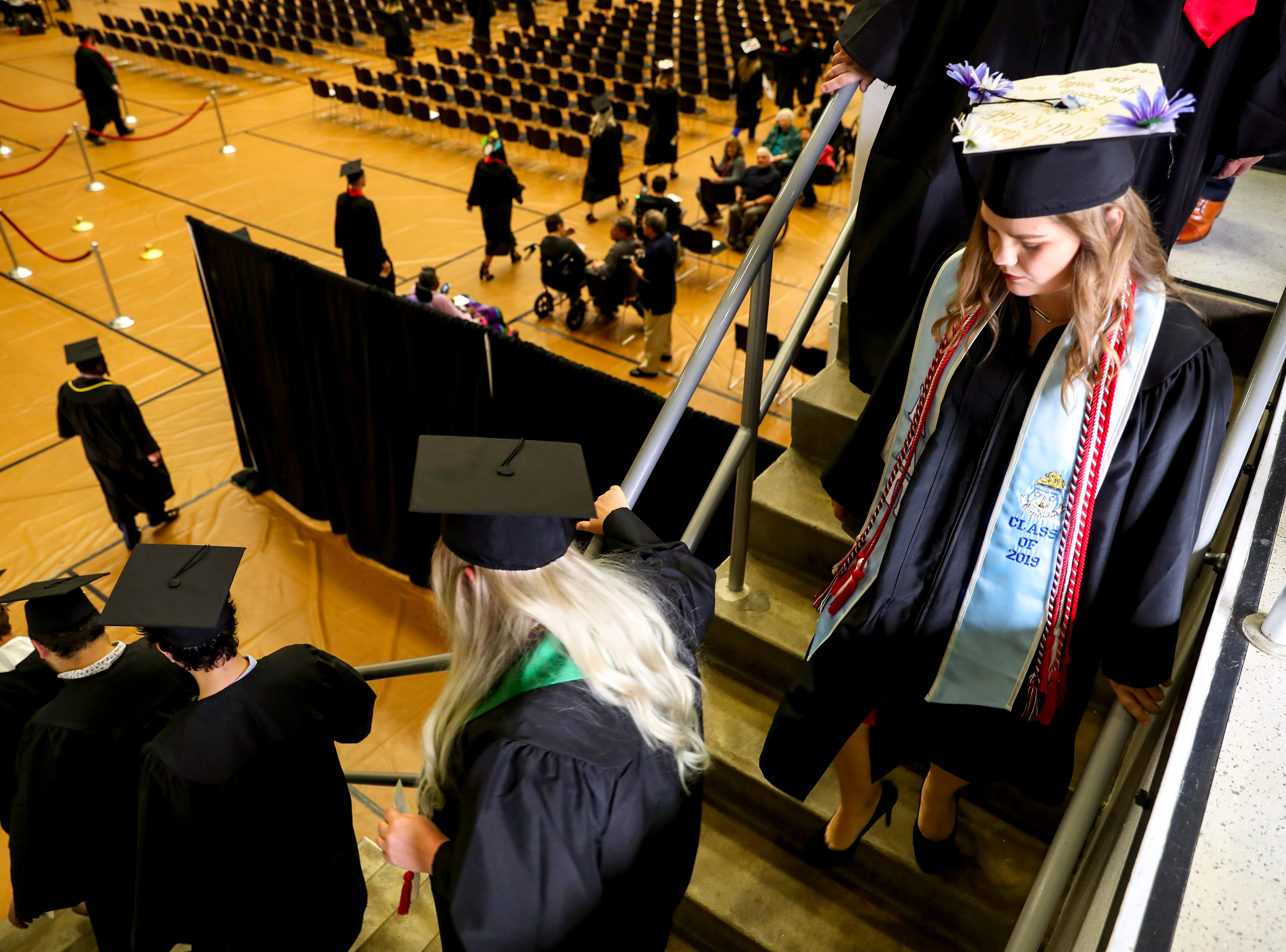 Graduating students walk down flanking staircases to head to their seats at the Austin Peay spring commencement ceremony 2019 for College of Business and College of STEM at Winfield Dunn Center in Clarksville, Tenn., on Friday, May 3, 2019.
