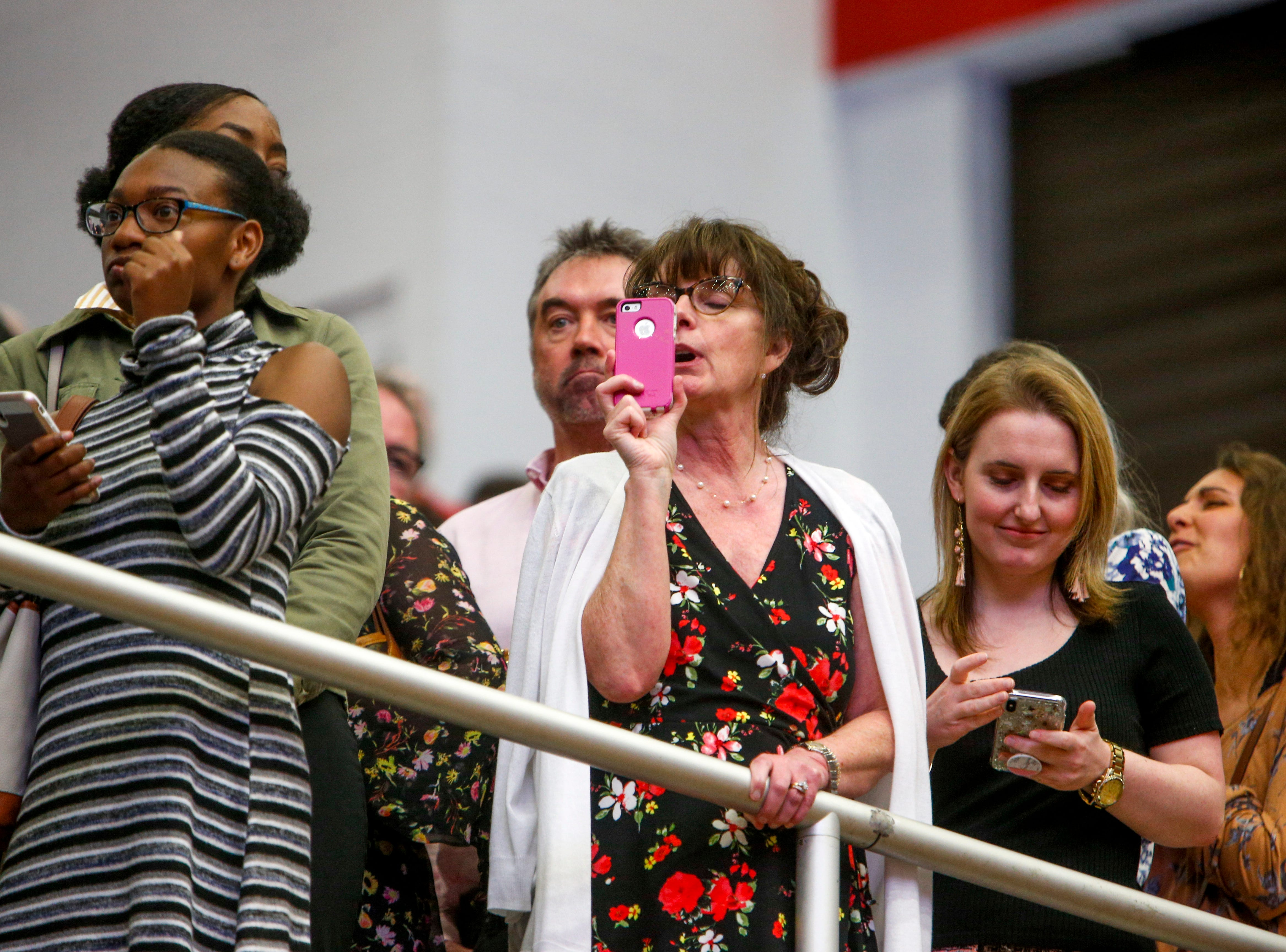Friends and family take photo and video with cell phones at the Austin Peay spring commencement ceremony 2019 for College of Business and College of STEM at Winfield Dunn Center in Clarksville, Tenn., on Friday, May 3, 2019.