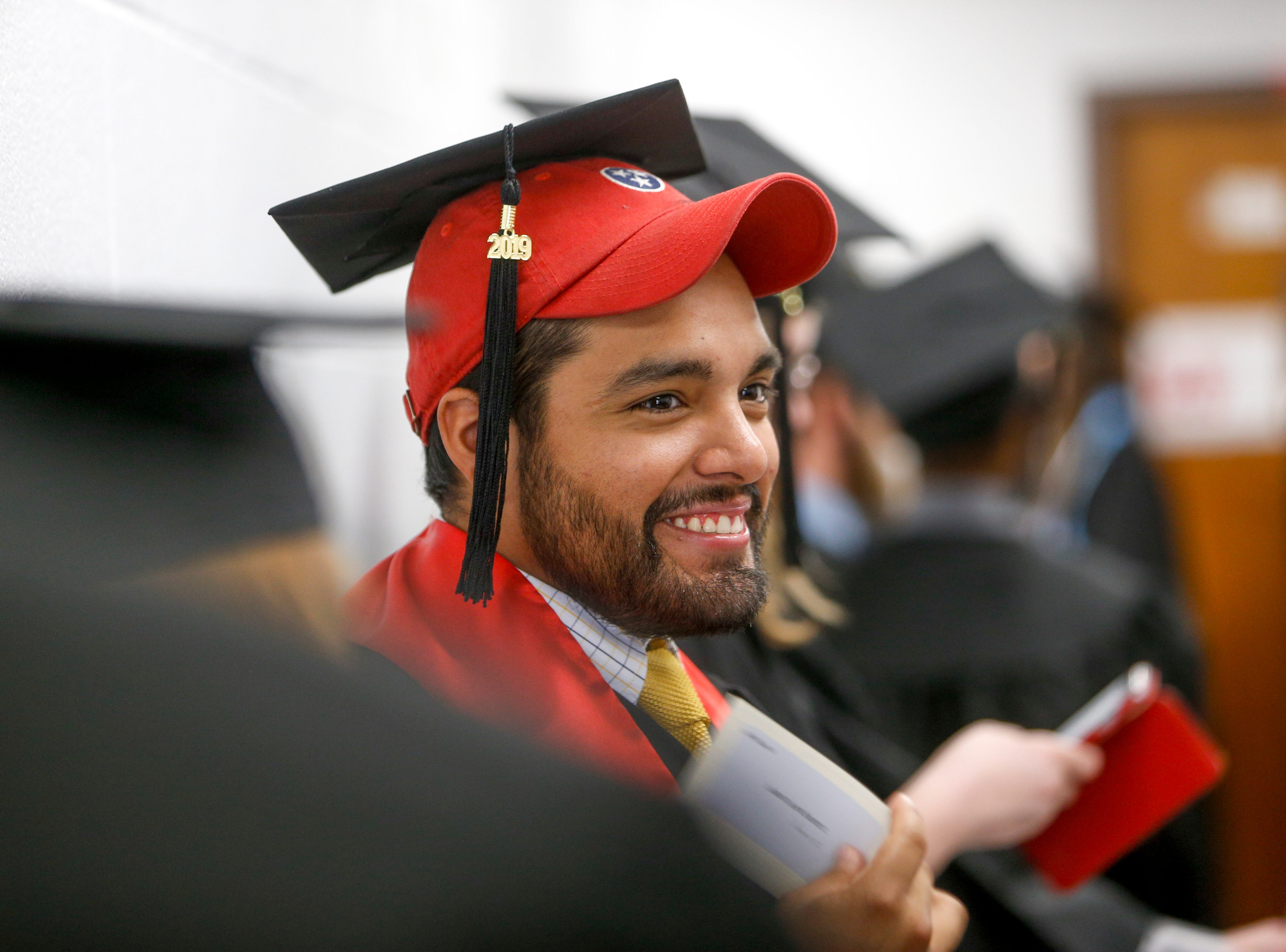 Students chat with one another in the hallways before heading into graduation at the Austin Peay spring commencement ceremony 2019 for College of Business and College of STEM at Winfield Dunn Center in Clarksville, Tenn., on Friday, May 3, 2019.