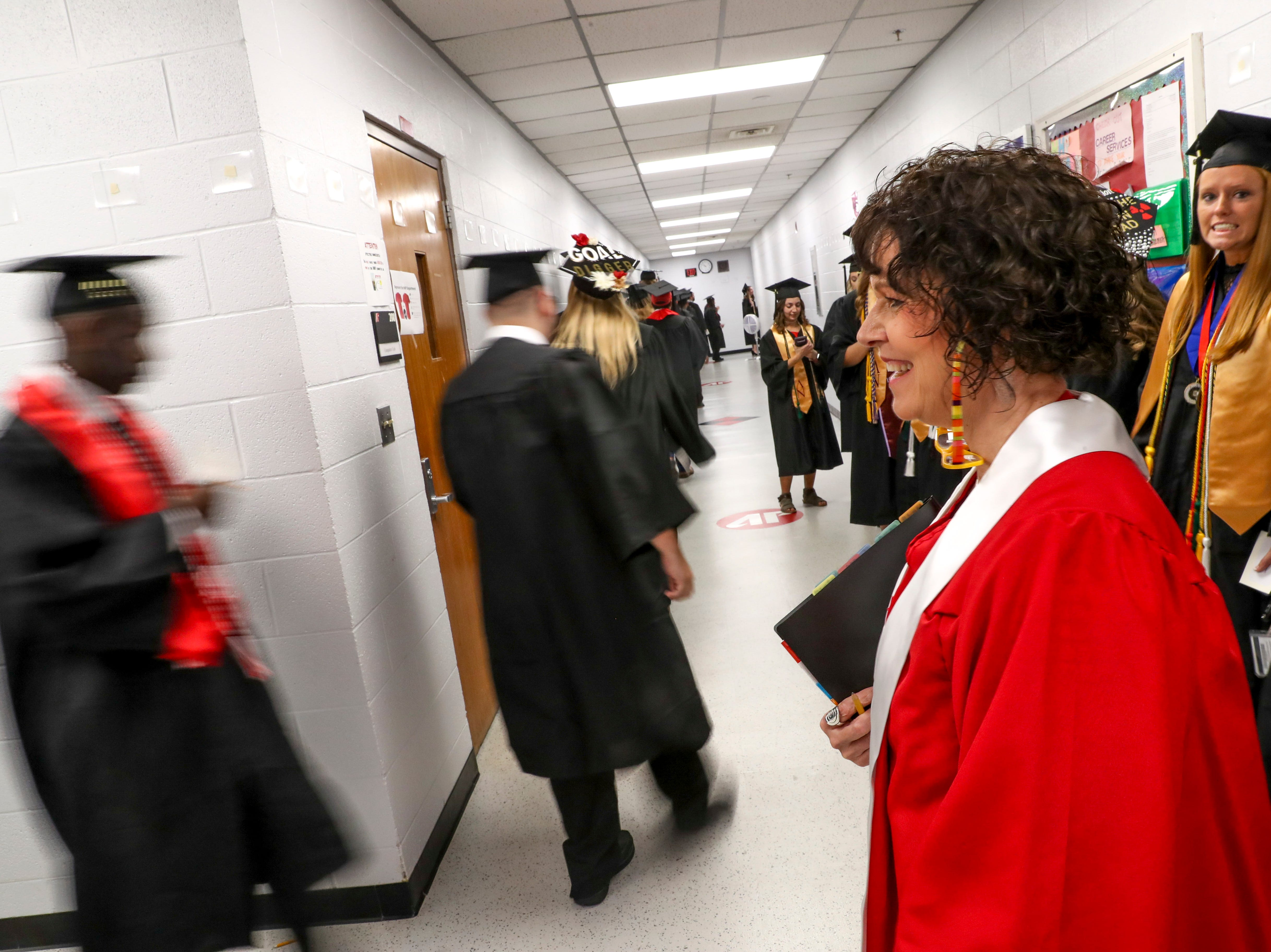 Students walk in file down the hallway before entering the auditorium at the Austin Peay spring commencement ceremony 2019 for College of Business and College of STEM at Winfield Dunn Center in Clarksville, Tenn., on Friday, May 3, 2019.