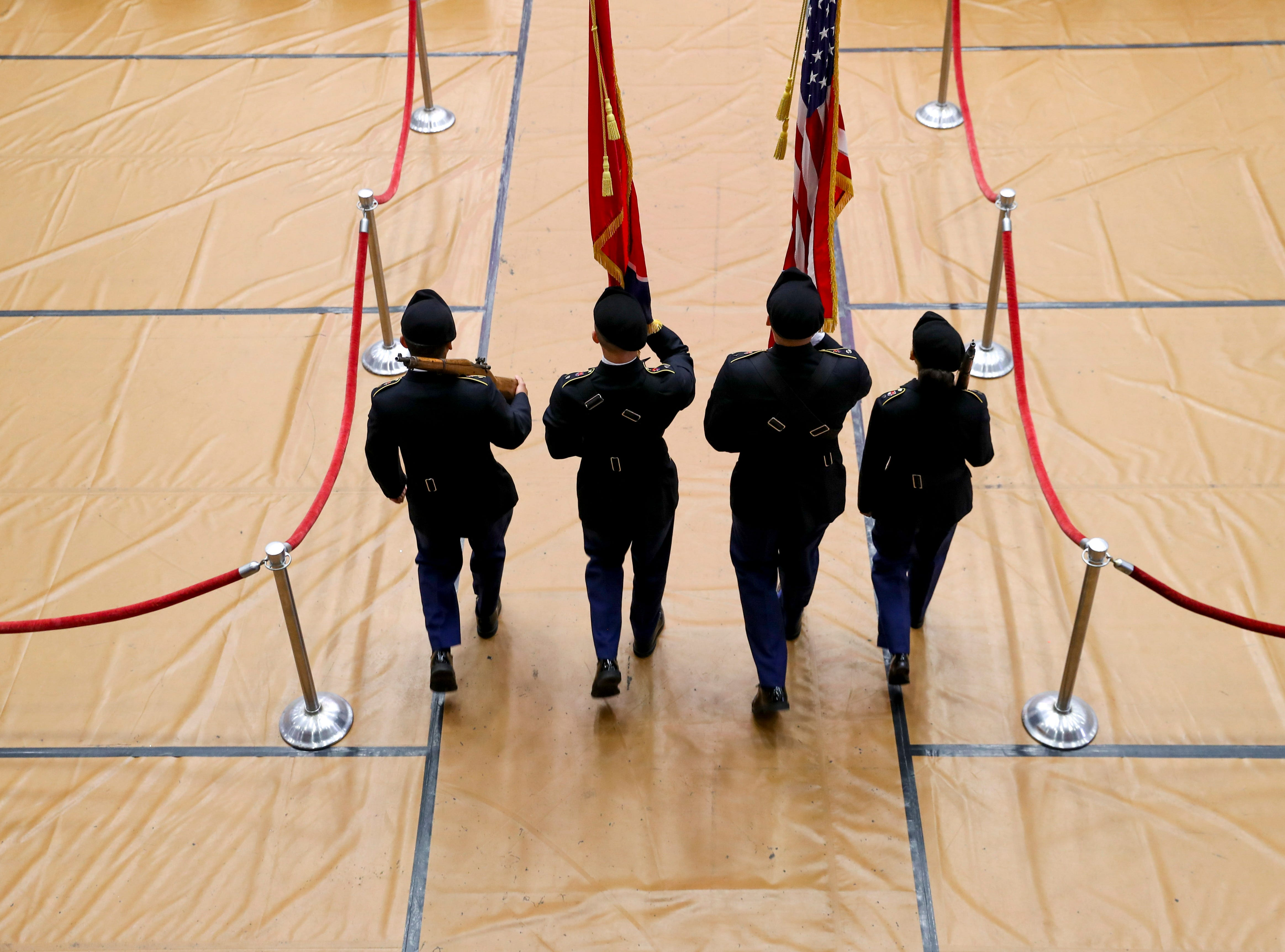 ROTC color guard member present the colors at the Austin Peay spring commencement ceremony 2019 for College of Business and College of STEM at Winfield Dunn Center in Clarksville, Tenn., on Friday, May 3, 2019.