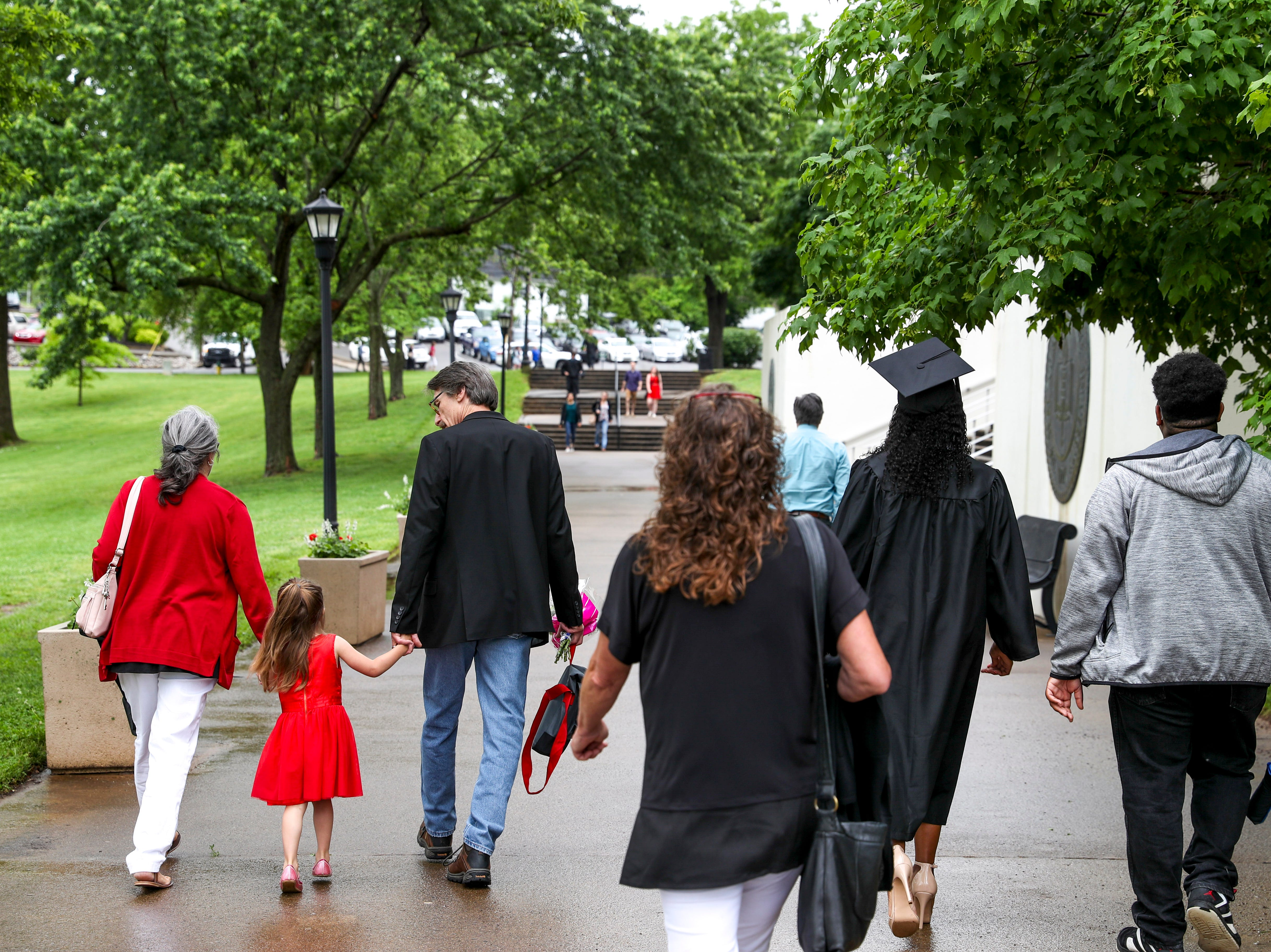 Families and students approach at the Austin Peay spring commencement ceremony 2019 for College of Business and College of STEM at Winfield Dunn Center in Clarksville, Tenn., on Friday, May 3, 2019.