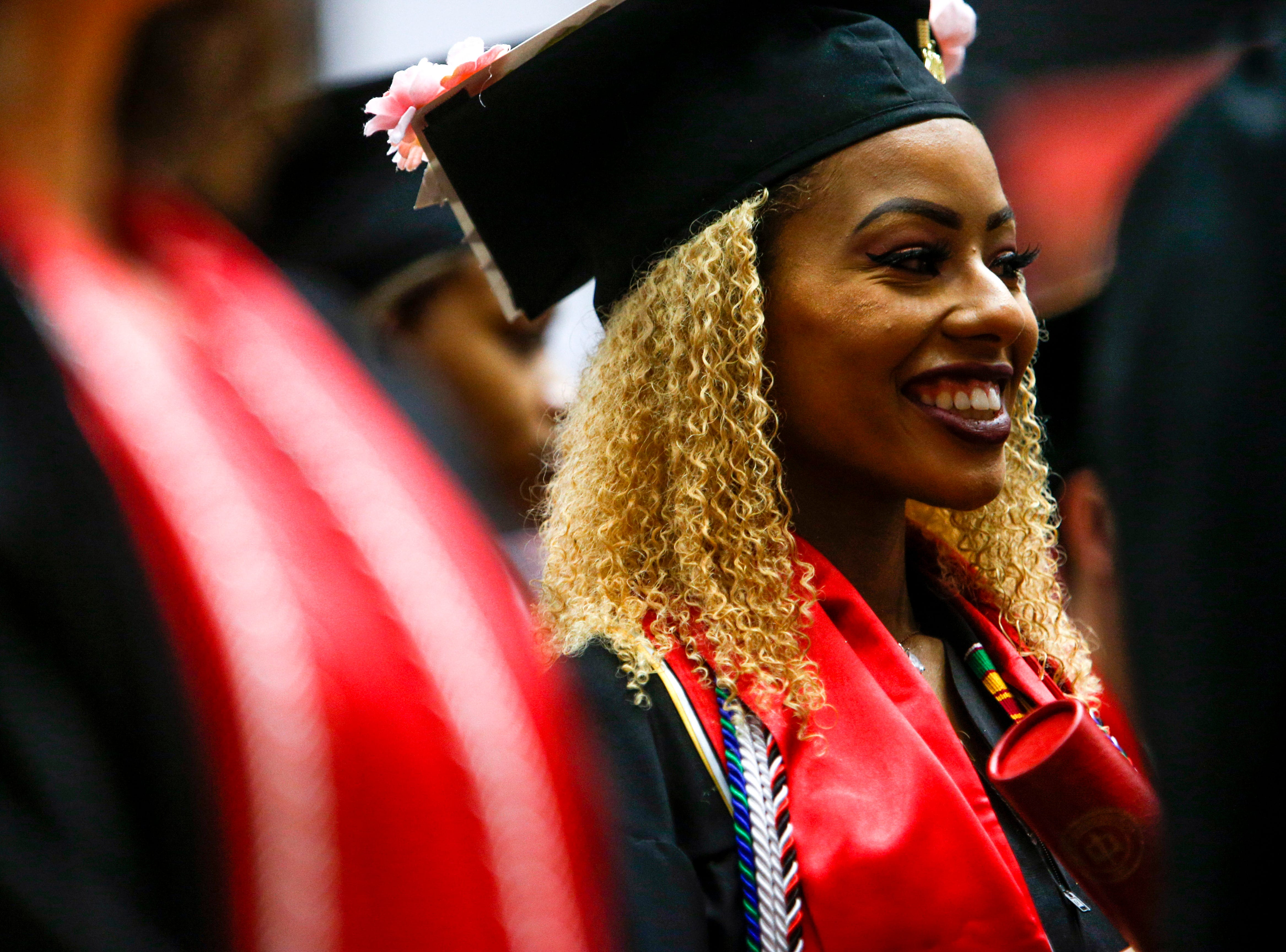 Students smile in the final moments before being dismissed to friends and family at the Austin Peay spring commencement ceremony 2019 for College of Business and College of STEM at Winfield Dunn Center in Clarksville, Tenn., on Friday, May 3, 2019.