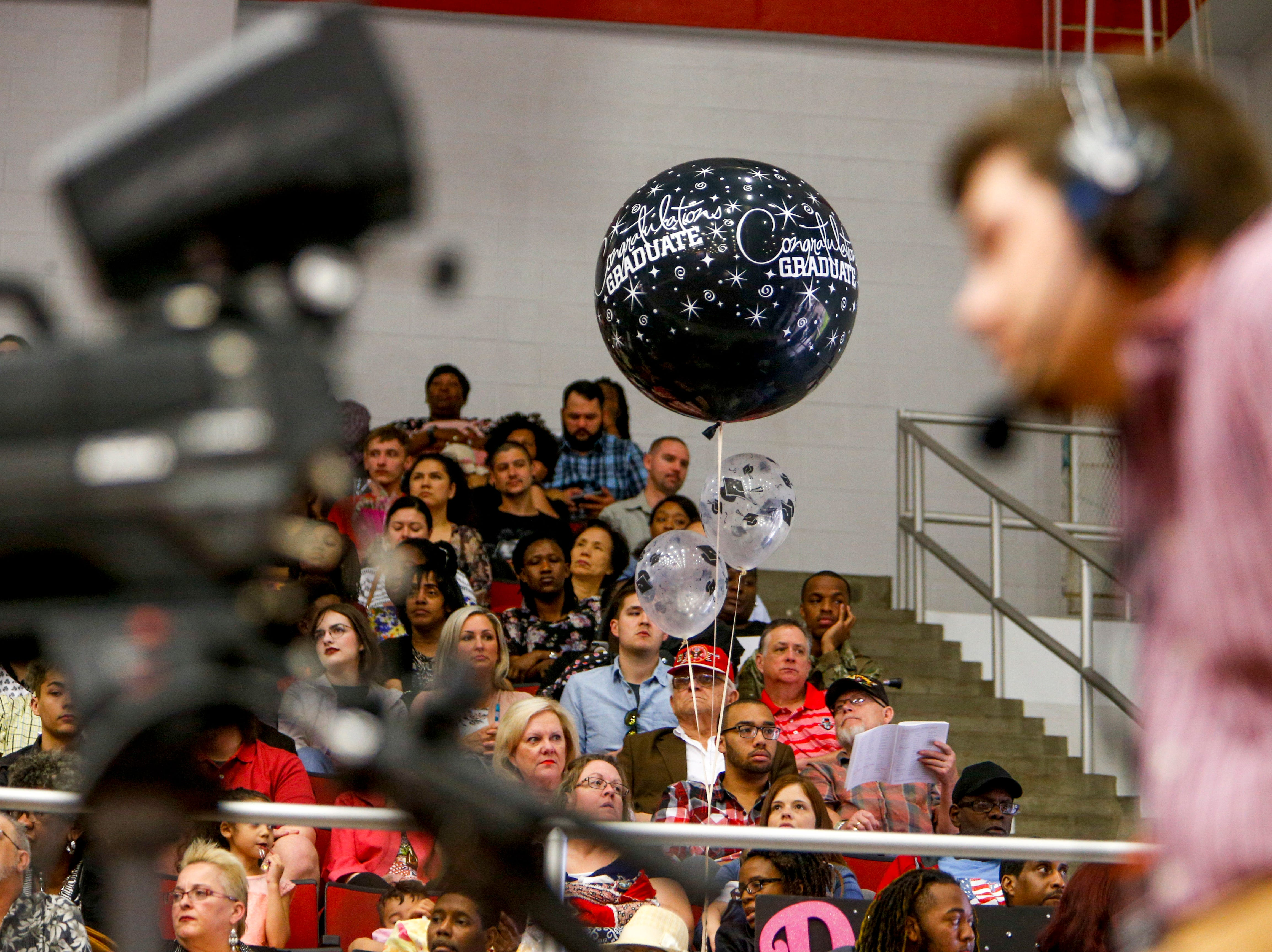 A large balloon floats above the crowd watching students receive diplomas at the Austin Peay spring commencement ceremony 2019 for College of Business and College of STEM at Winfield Dunn Center in Clarksville, Tenn., on Friday, May 3, 2019.