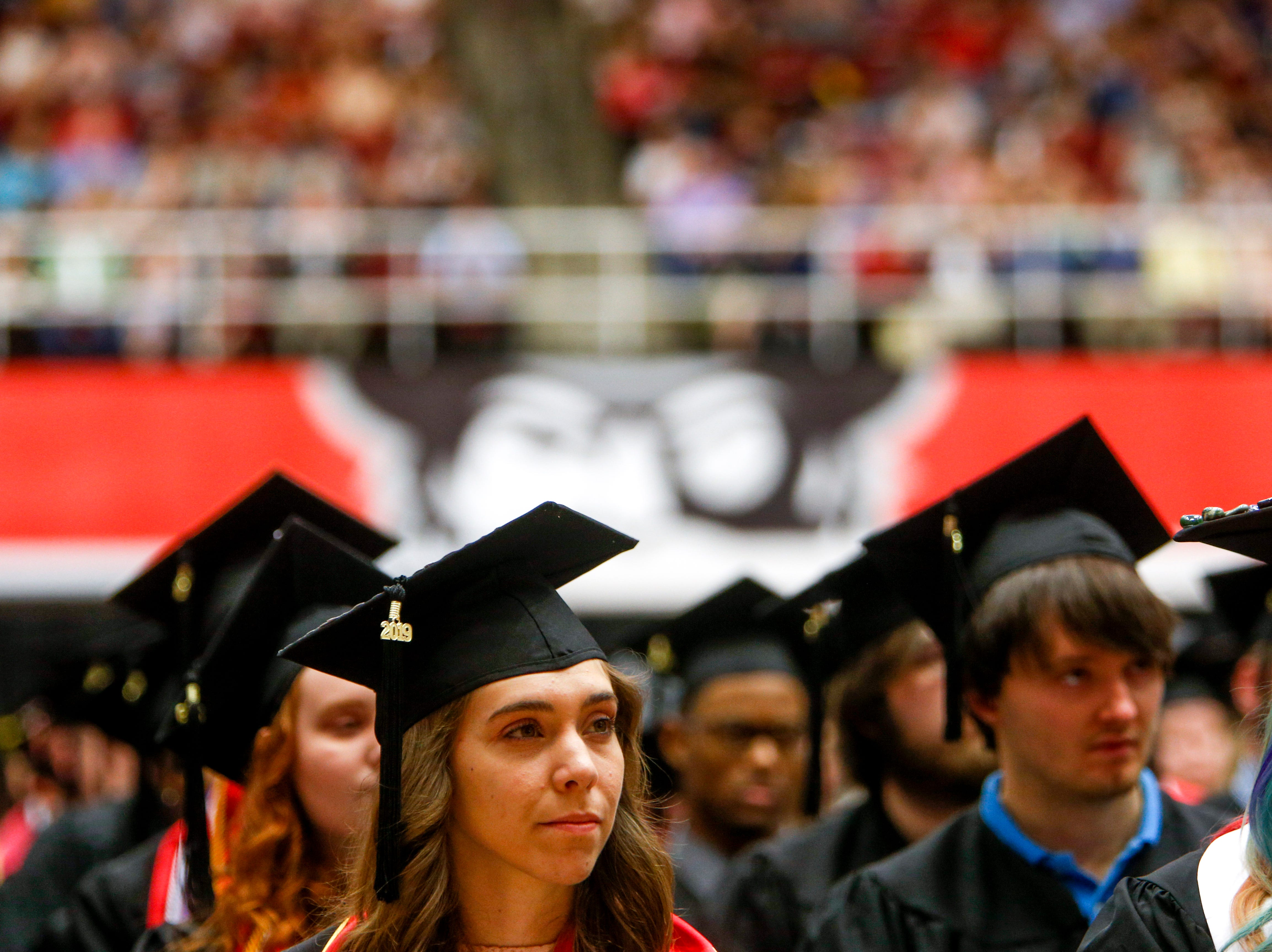 Students listen to former Tennessee Gov Bill Haslam speak at the Austin Peay spring commencement ceremony 2019 for College of Business and College of STEM at Winfield Dunn Center in Clarksville, Tenn., on Friday, May 3, 2019.