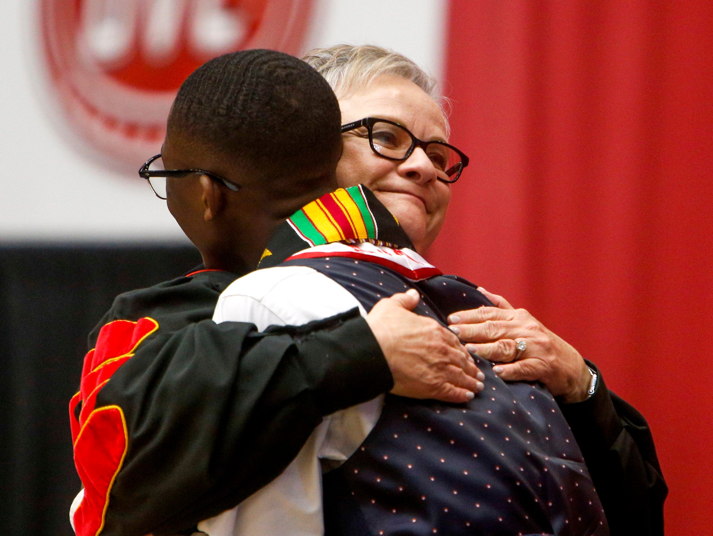 A speaker welcomes and embraces a member of student government at the Austin Peay spring commencement ceremony 2019 for College of Business and College of STEM at Winfield Dunn Center in Clarksville, Tenn., on Friday, May 3, 2019.