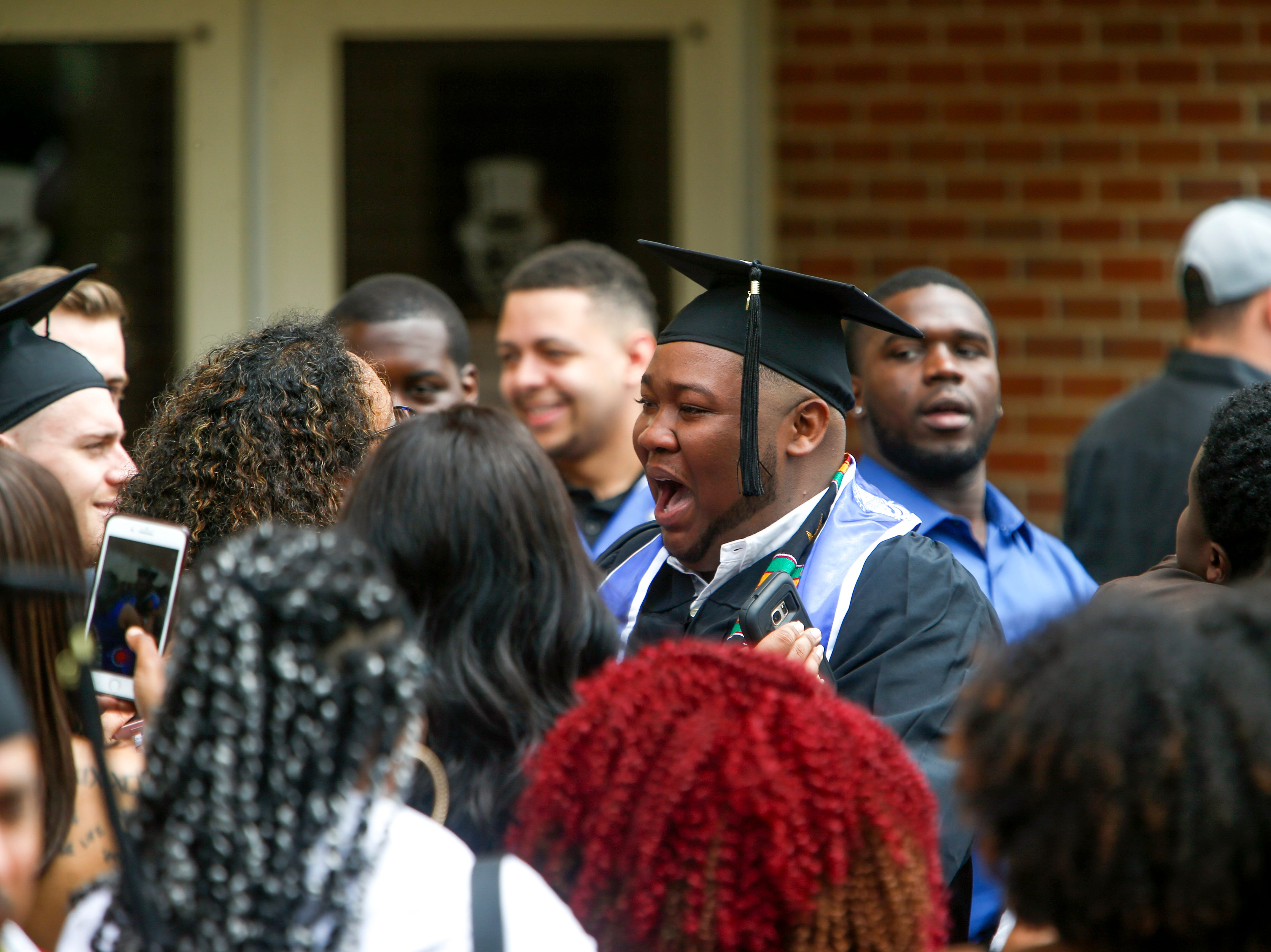 Students celebrate with family and friends outside at the Austin Peay spring commencement ceremony 2019 for College of Business and College of STEM at Winfield Dunn Center in Clarksville, Tenn., on Friday, May 3, 2019.