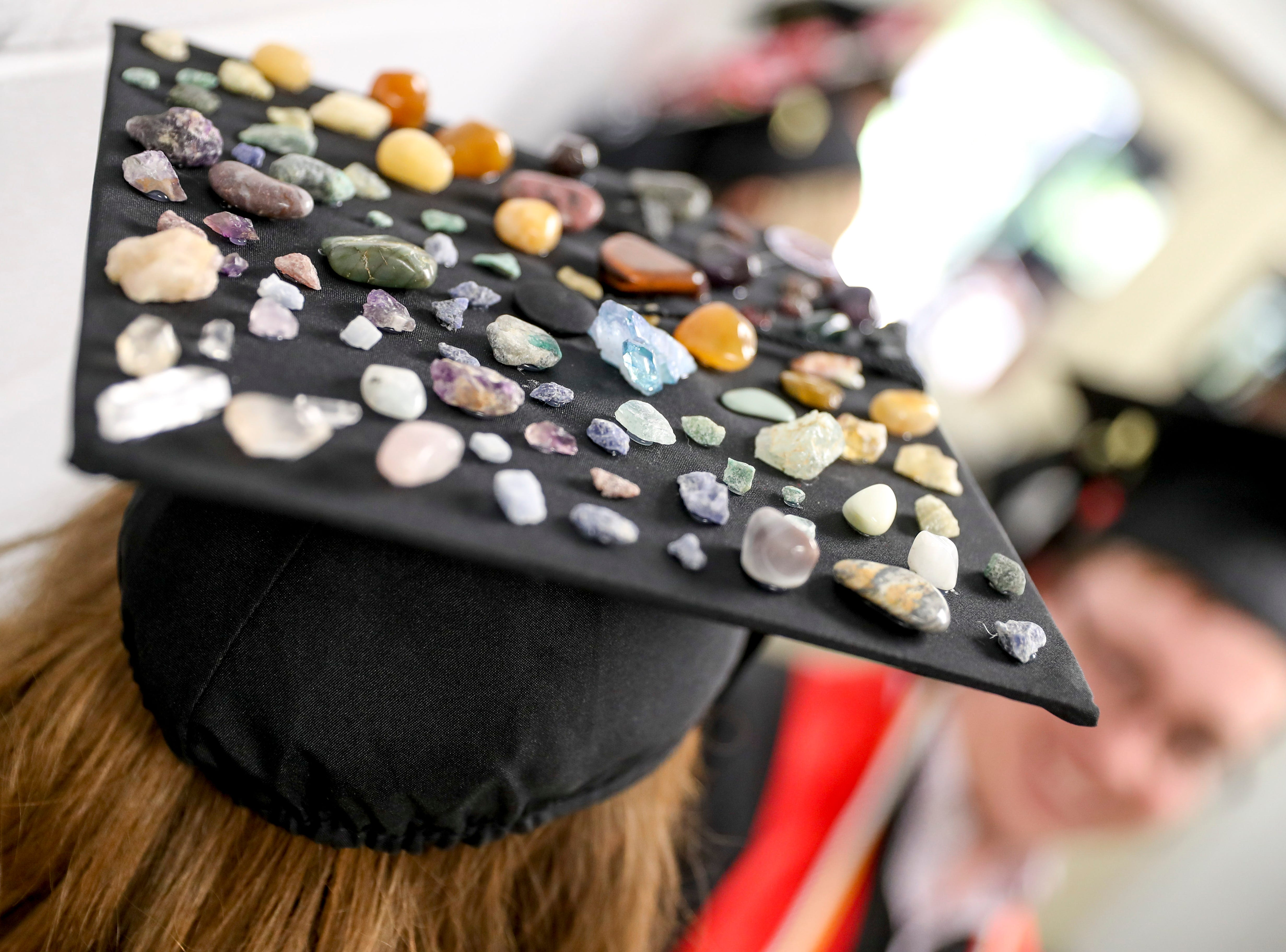 A geology student adorned her cap with stones and minerals at the Austin Peay spring commencement ceremony 2019 for College of Business and College of STEM at Winfield Dunn Center in Clarksville, Tenn., on Friday, May 3, 2019.