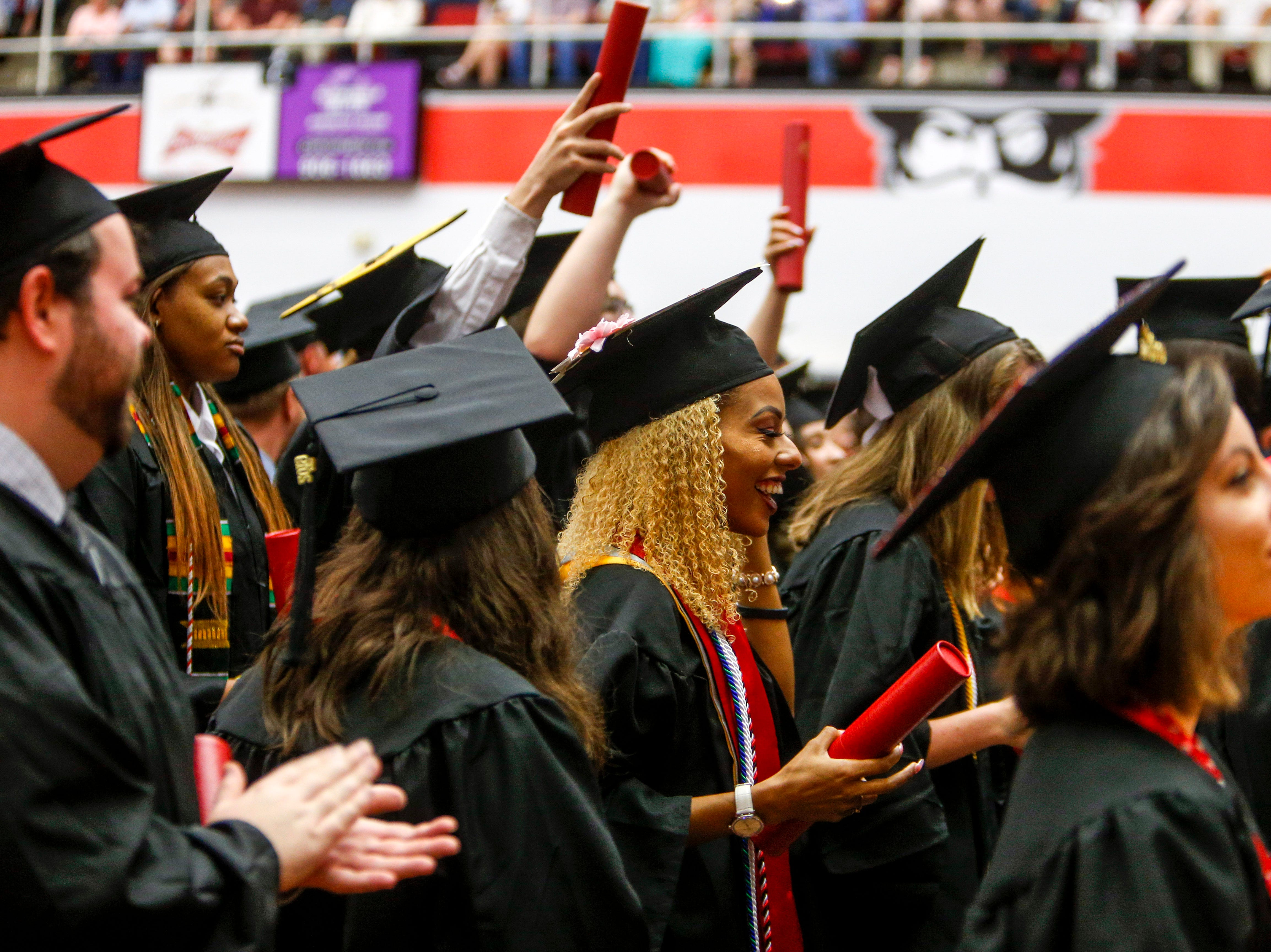 APSU students cheer for fellow graduates at the Austin Peay spring commencement ceremony 2019 for College of Business and College of STEM at Winfield Dunn Center in Clarksville, Tenn., on Friday, May 3, 2019.