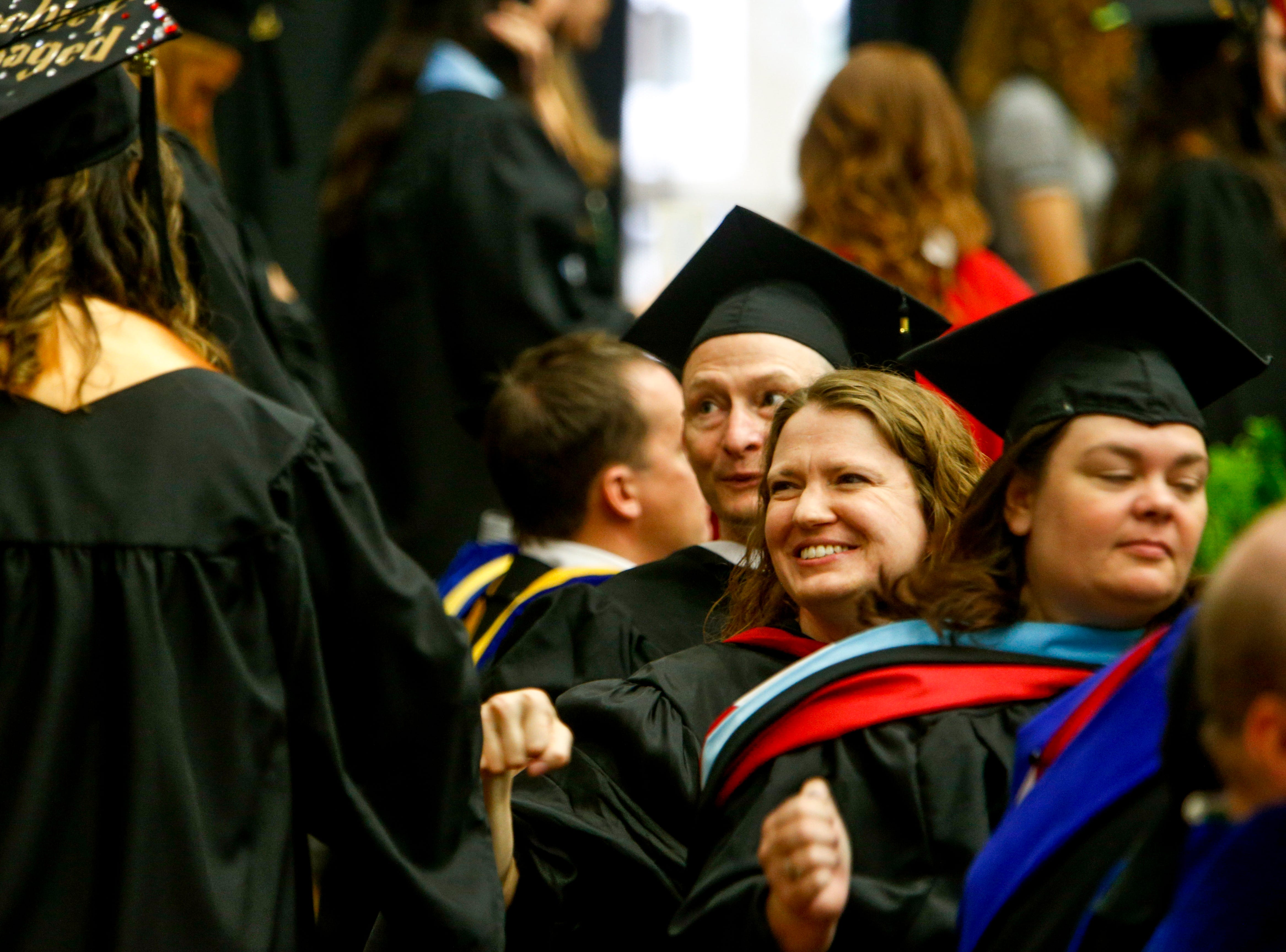 Teachers greet their students walking to receive their diplomas at the Austin Peay spring commencement ceremony 2019 for College of Business and College of STEM at Winfield Dunn Center in Clarksville, Tenn., on Friday, May 3, 2019.