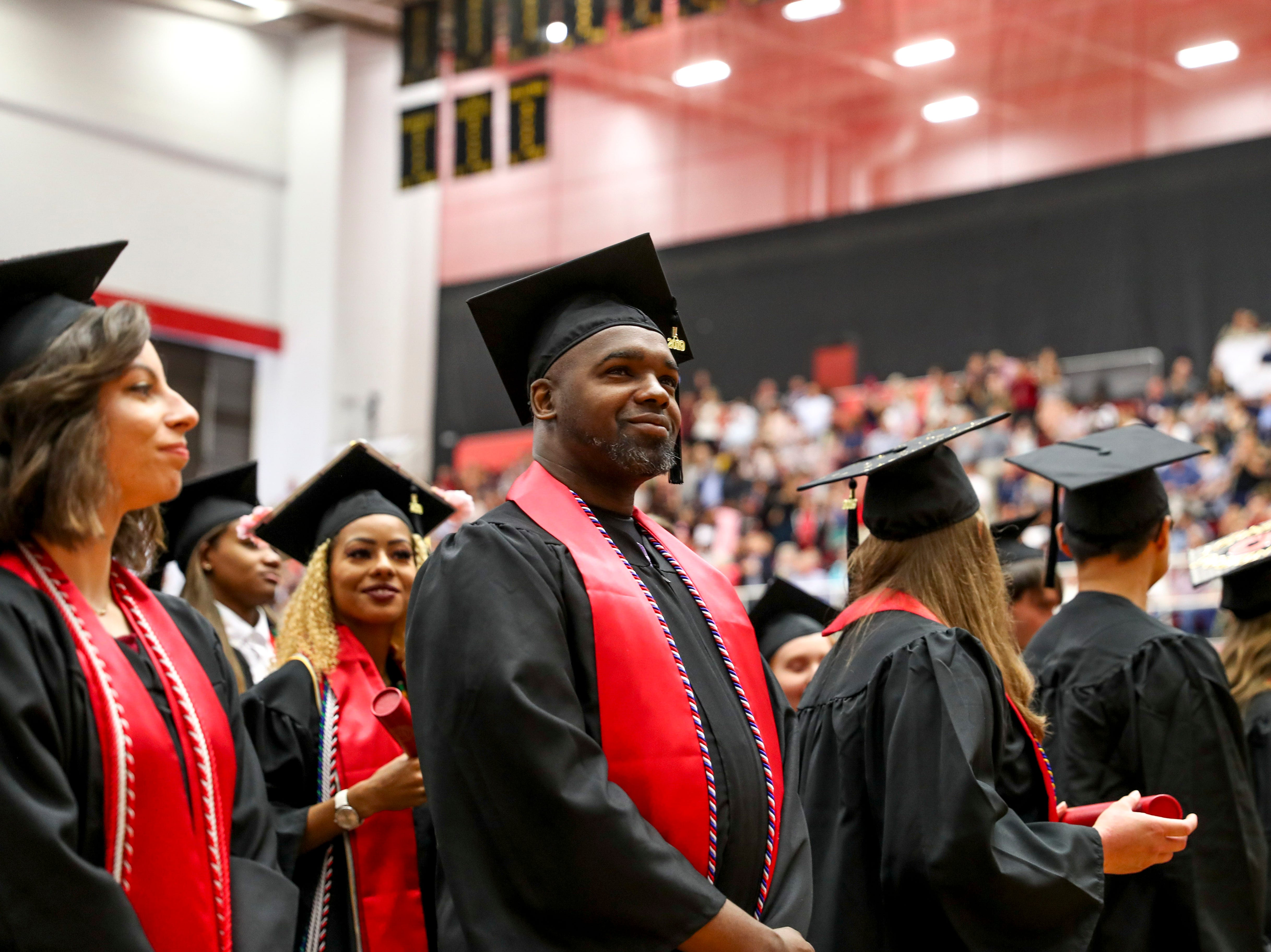 APSU students look out across family and friends that gathered to celebrate their graduation at the Austin Peay spring commencement ceremony 2019 for College of Business and College of STEM at Winfield Dunn Center in Clarksville, Tenn., on Friday, May 3, 2019.