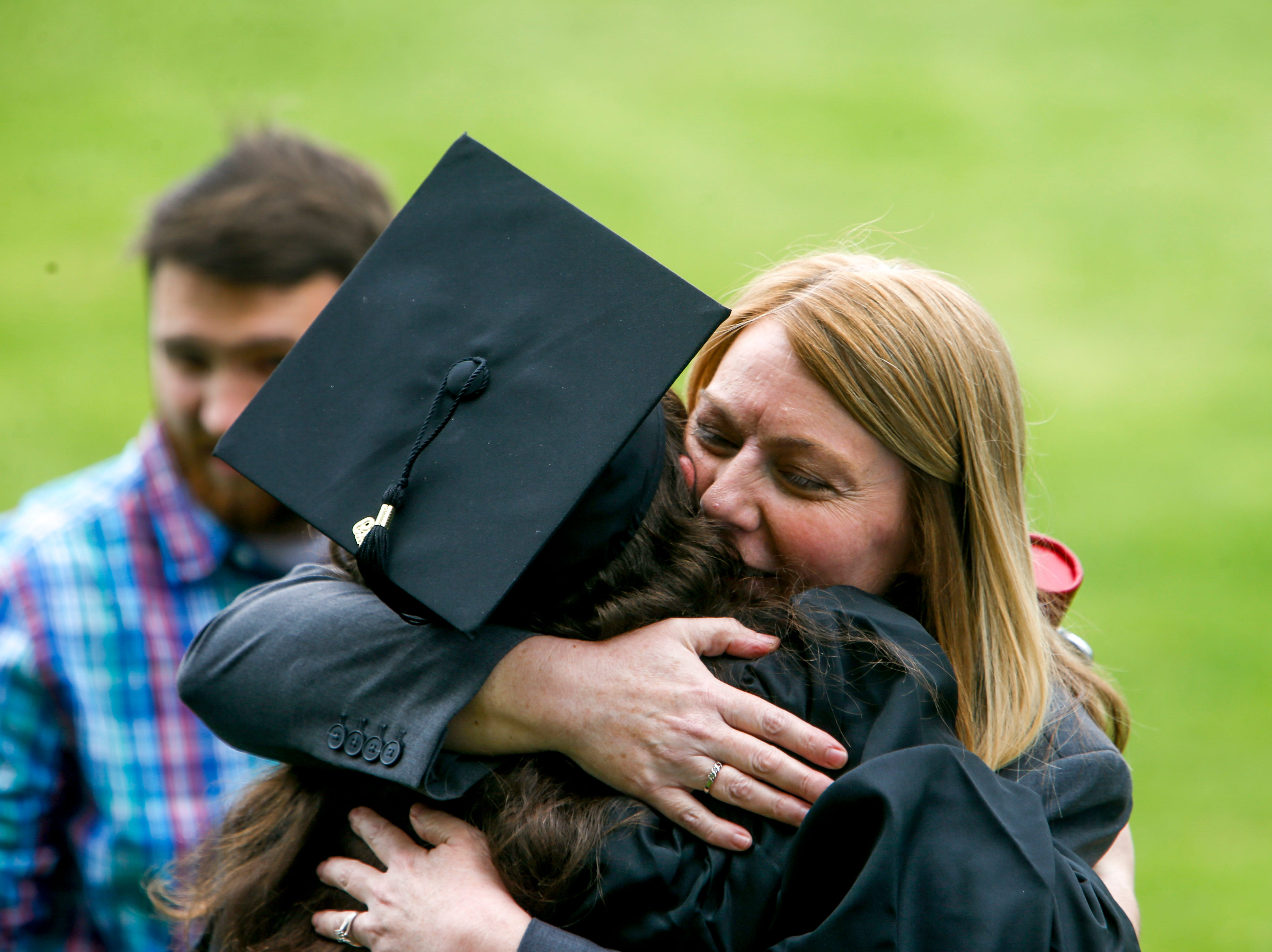 Students celebrate with family and friends after graduating at the Austin Peay spring commencement ceremony 2019 for College of Business and College of STEM at Winfield Dunn Center in Clarksville, Tenn., on Friday, May 3, 2019.