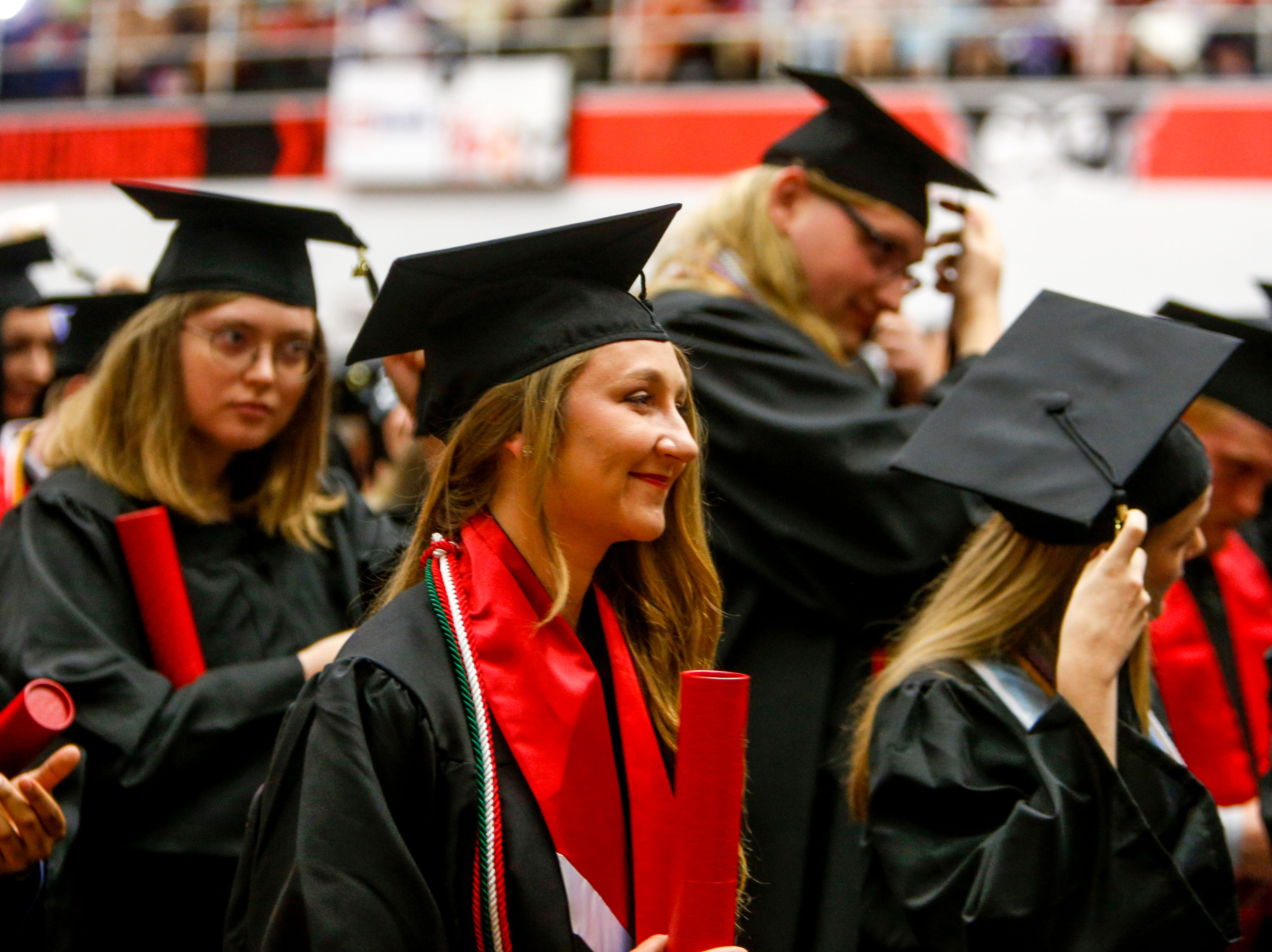 Students smile after turning over their tassel following receiving their diplomas at the Austin Peay spring commencement ceremony 2019 for College of Business and College of STEM at Winfield Dunn Center in Clarksville, Tenn., on Friday, May 3, 2019.