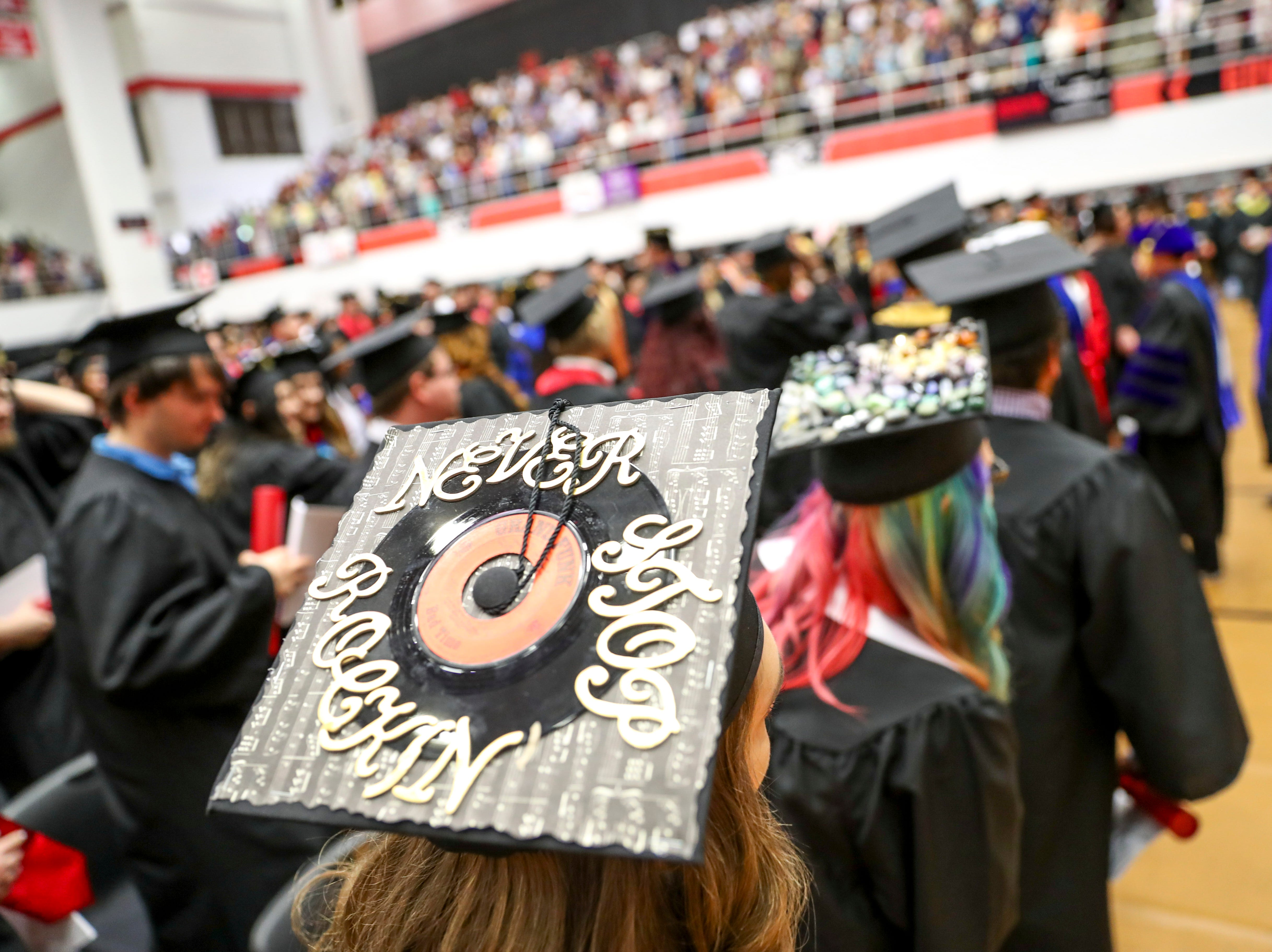 A student decorated their cap with a vinyl record at the Austin Peay spring commencement ceremony 2019 for College of Business and College of STEM at Winfield Dunn Center in Clarksville, Tenn., on Friday, May 3, 2019.