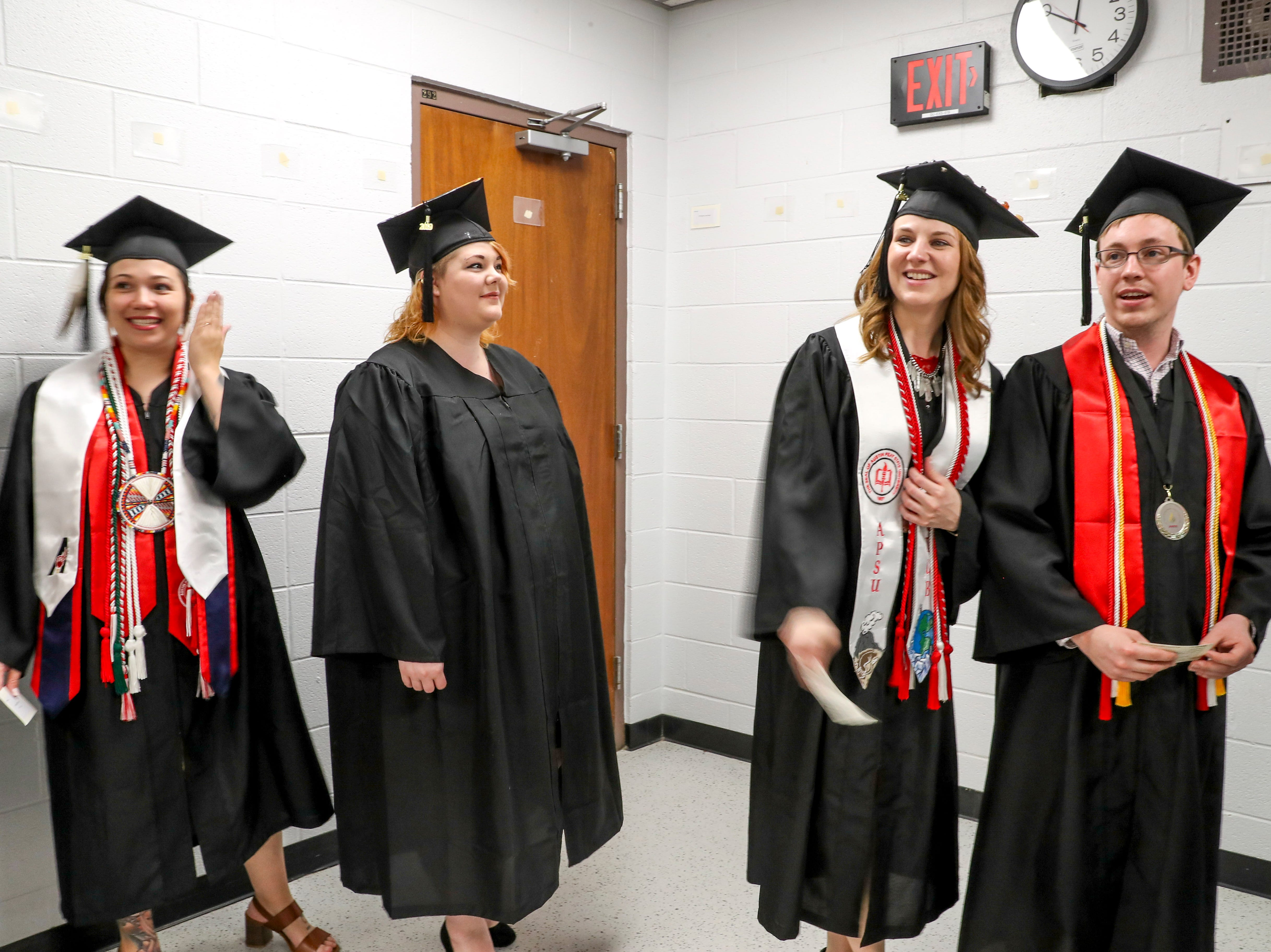 Students look down the hallway towards their fellow graduates at the Austin Peay spring commencement ceremony 2019 for College of Business and College of STEM at Winfield Dunn Center in Clarksville, Tenn., on Friday, May 3, 2019.