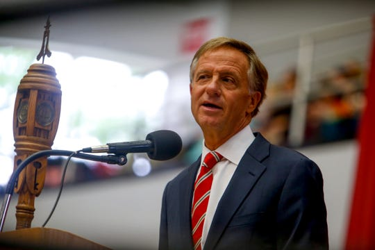 Former Tennessee Gov. Bill Haslam speaks to students graduating at the Austin Peay spring commencement ceremony 2019 for College of Business and College of STEM at Winfield Dunn Center in Clarksville, Tenn., on Friday, May 3, 2019.