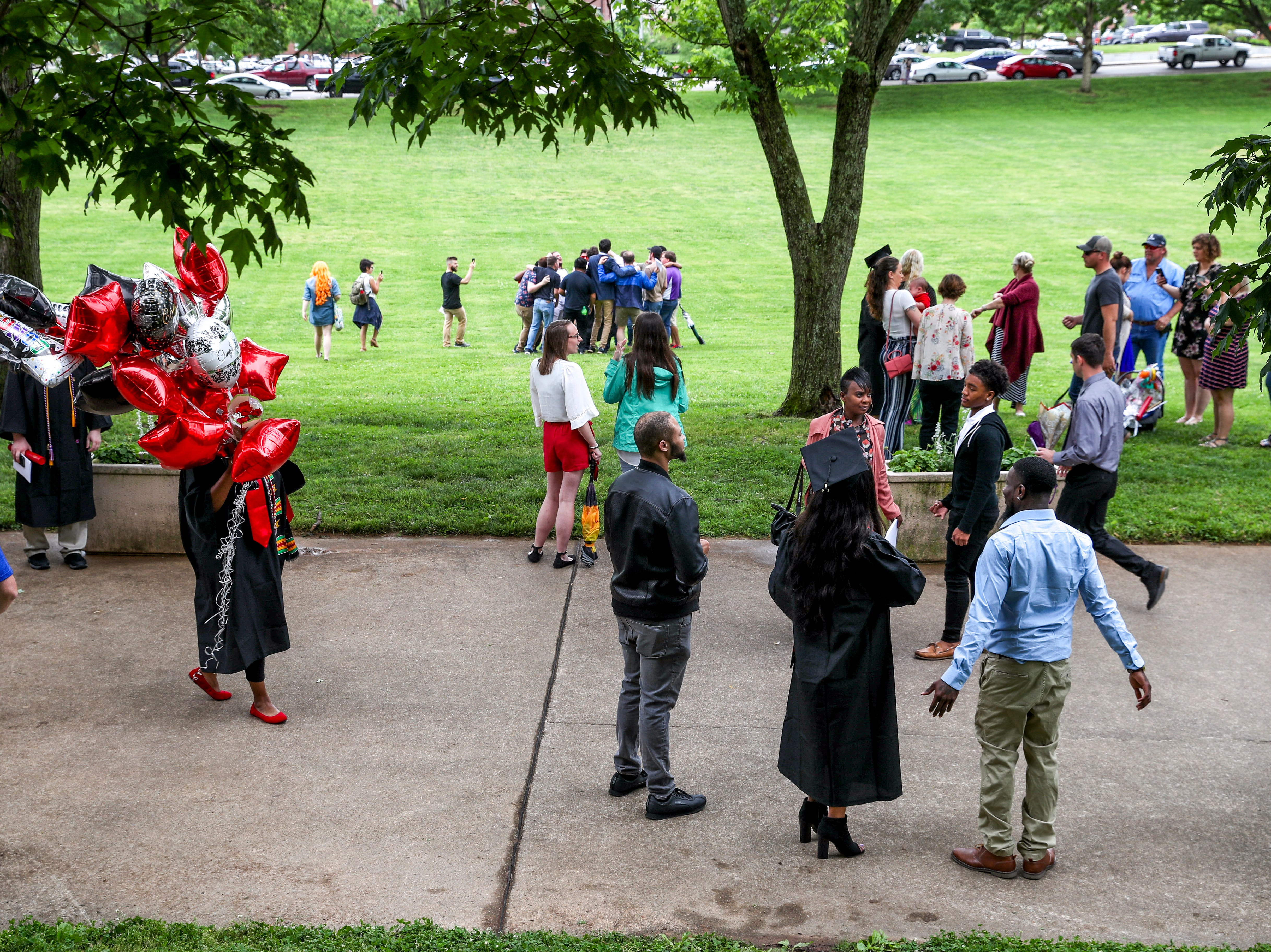 Students mingle with friends and family at the Austin Peay spring commencement ceremony 2019 for College of Business and College of STEM at Winfield Dunn Center in Clarksville, Tenn., on Friday, May 3, 2019.
