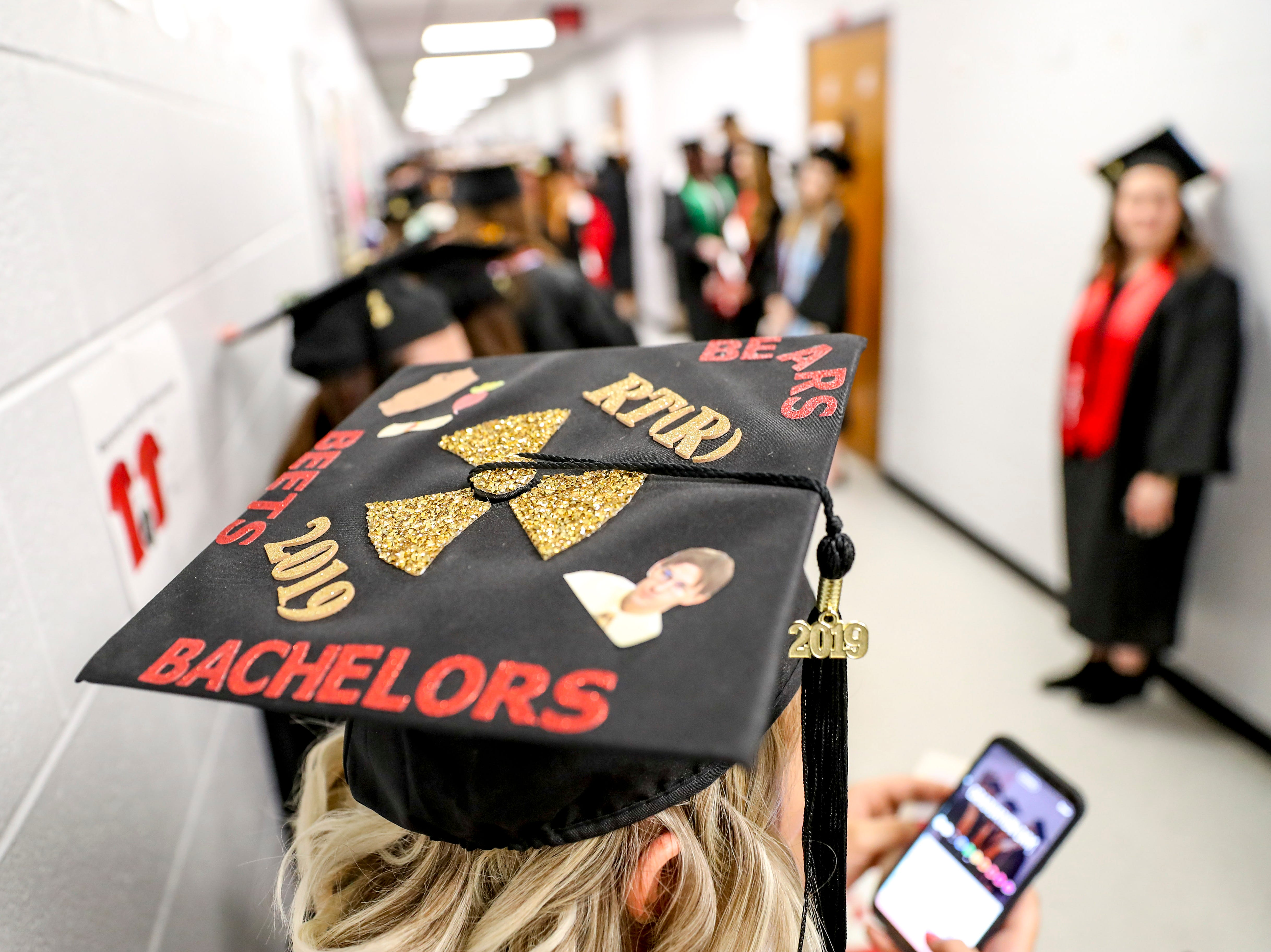 Decorated caps cover most of the heads at the Austin Peay spring commencement ceremony 2019 for College of Business and College of STEM at Winfield Dunn Center in Clarksville, Tenn., on Friday, May 3, 2019.