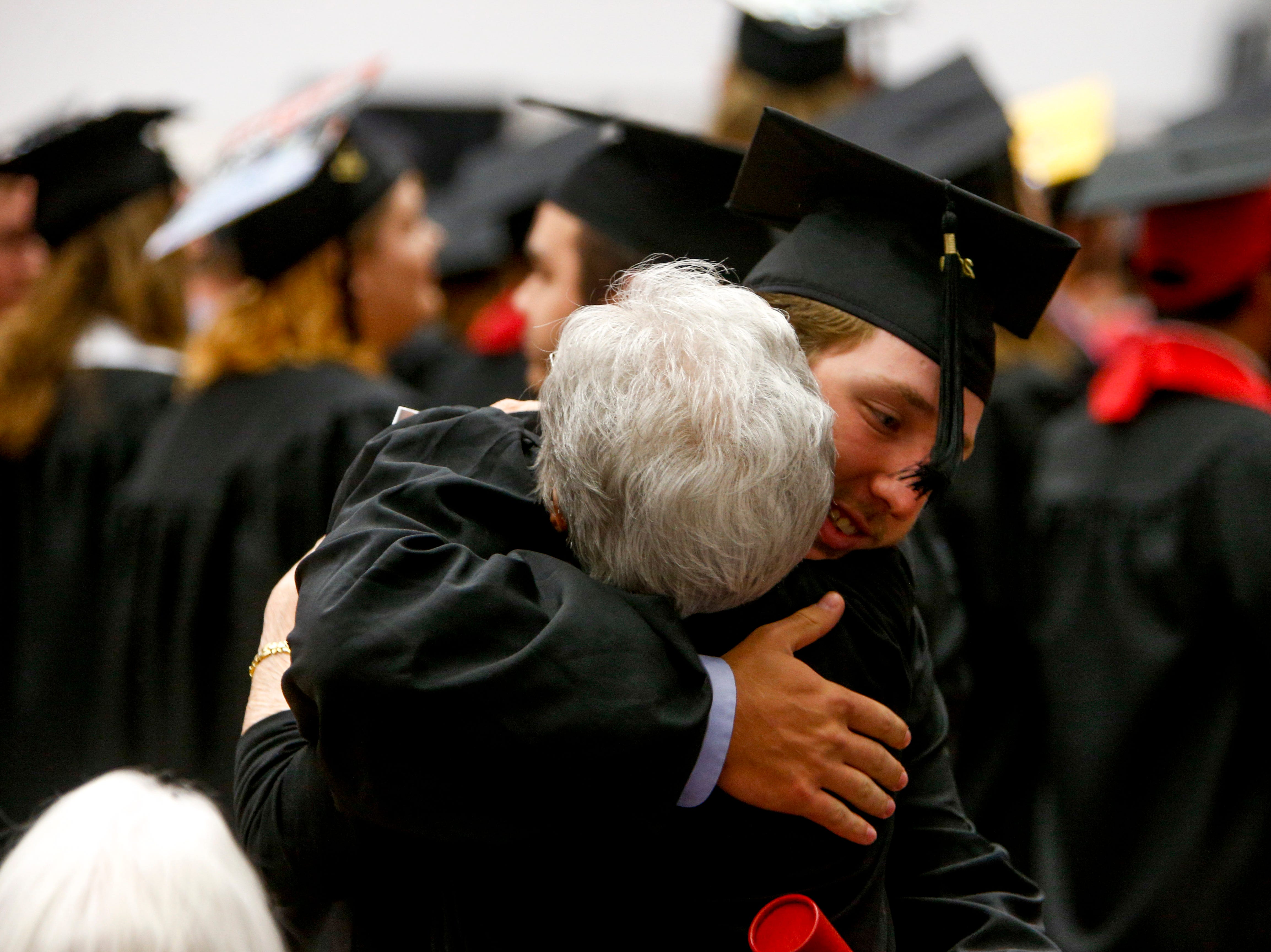 Students embrace family and friends after receiving their diploma at the Austin Peay spring commencement ceremony 2019 for College of Business and College of STEM at Winfield Dunn Center in Clarksville, Tenn., on Friday, May 3, 2019.