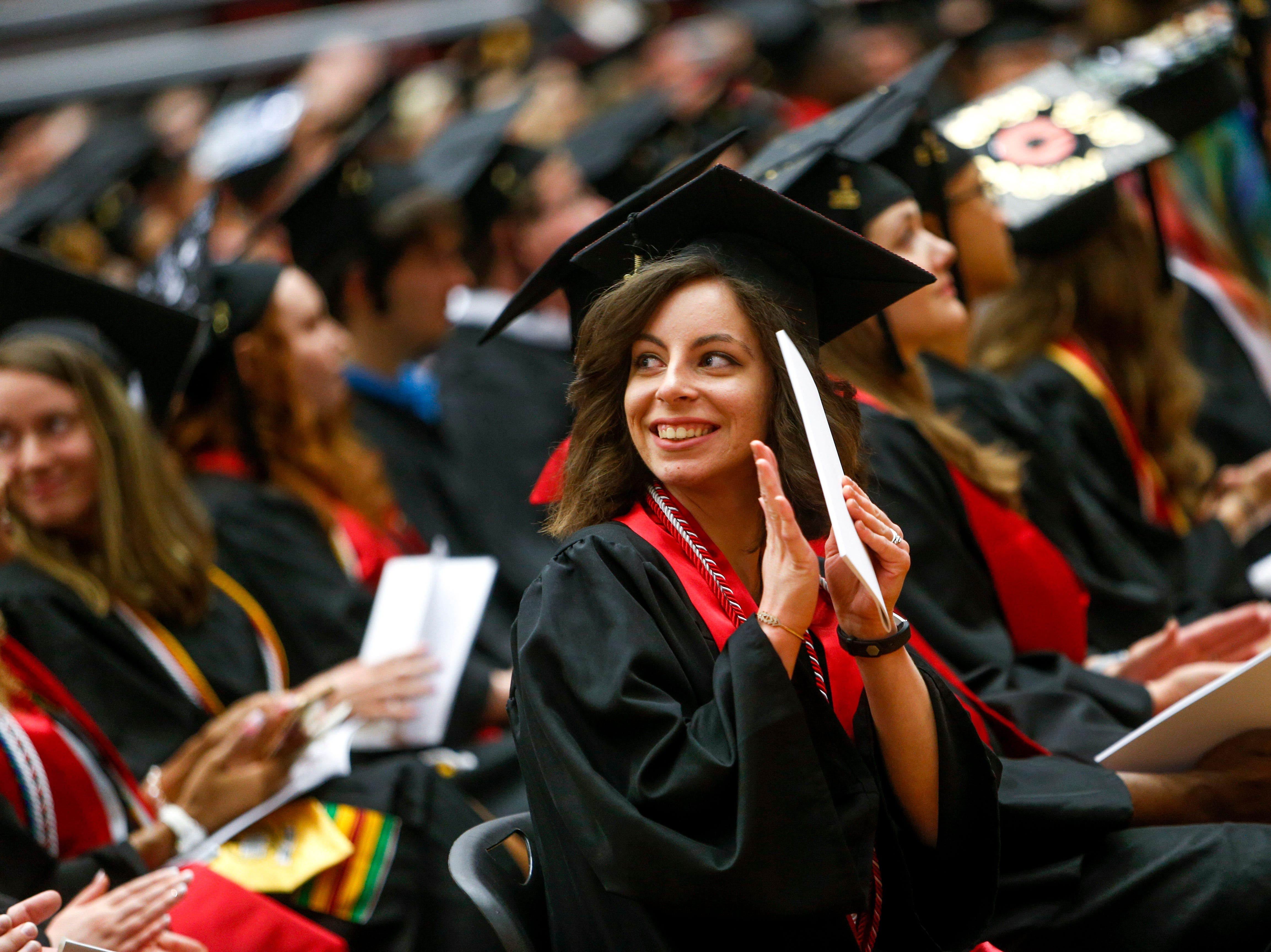 APSU students clap for family members in attendance at the Austin Peay spring commencement ceremony 2019 for College of Business and College of STEM at Winfield Dunn Center in Clarksville, Tenn., on Friday, May 3, 2019.