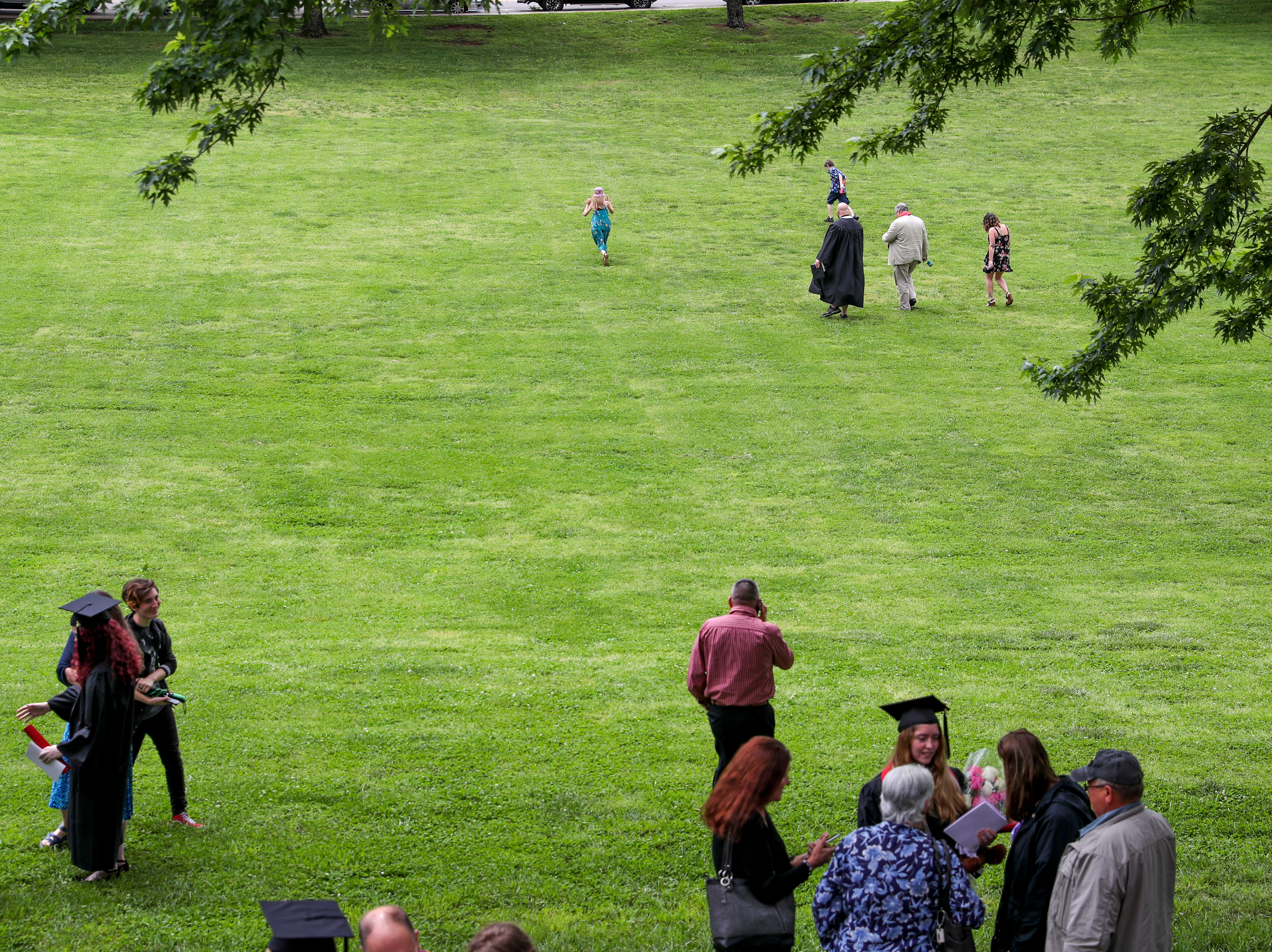 Families walk across the lawn at the Austin Peay spring commencement ceremony 2019 for College of Business and College of STEM at Winfield Dunn Center in Clarksville, Tenn., on Friday, May 3, 2019.