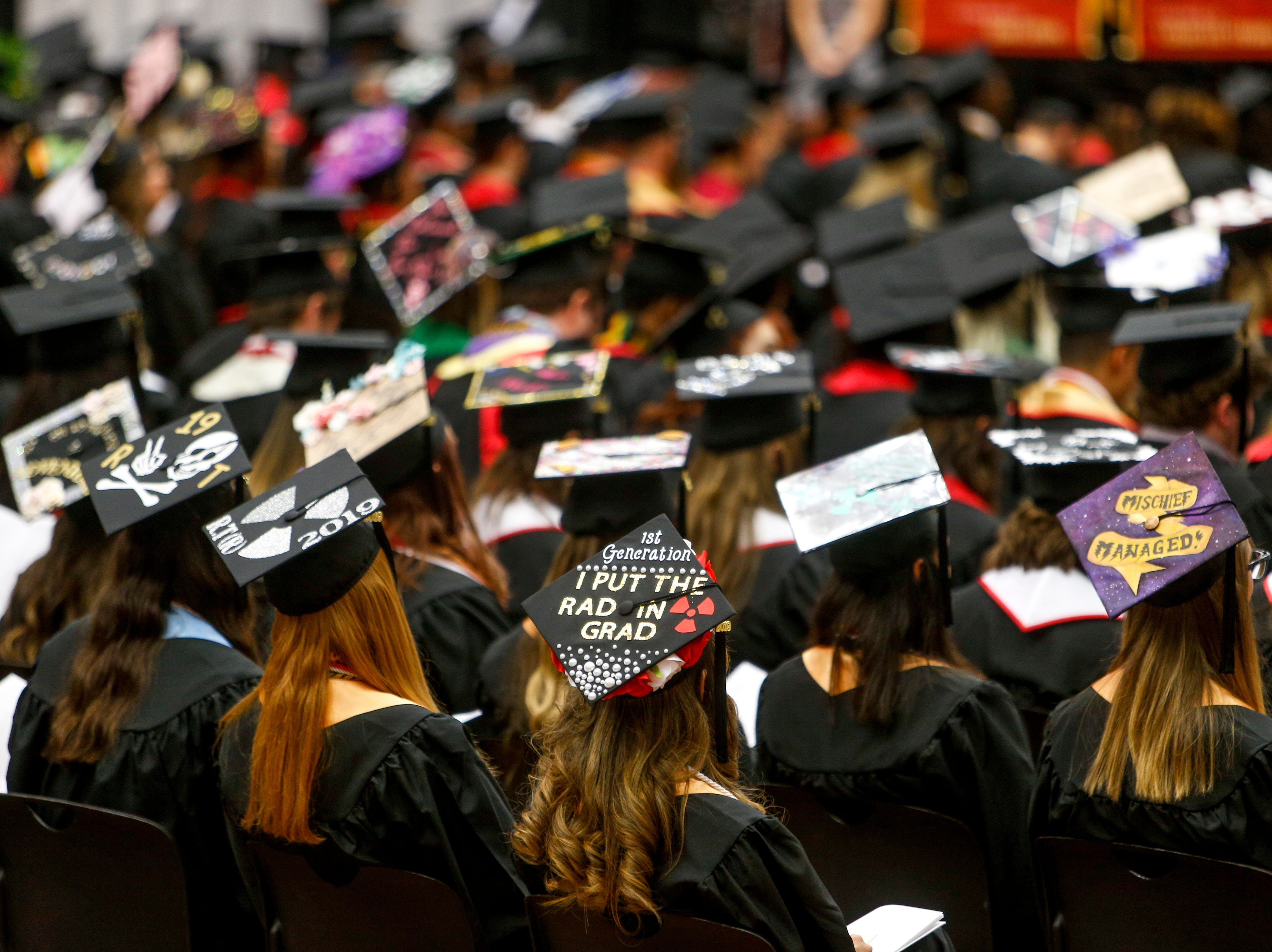 Graduates decorate their caps with personal notes and slogans at the Austin Peay spring commencement ceremony 2019 for College of Business and College of STEM at Winfield Dunn Center in Clarksville, Tenn., on Friday, May 3, 2019.