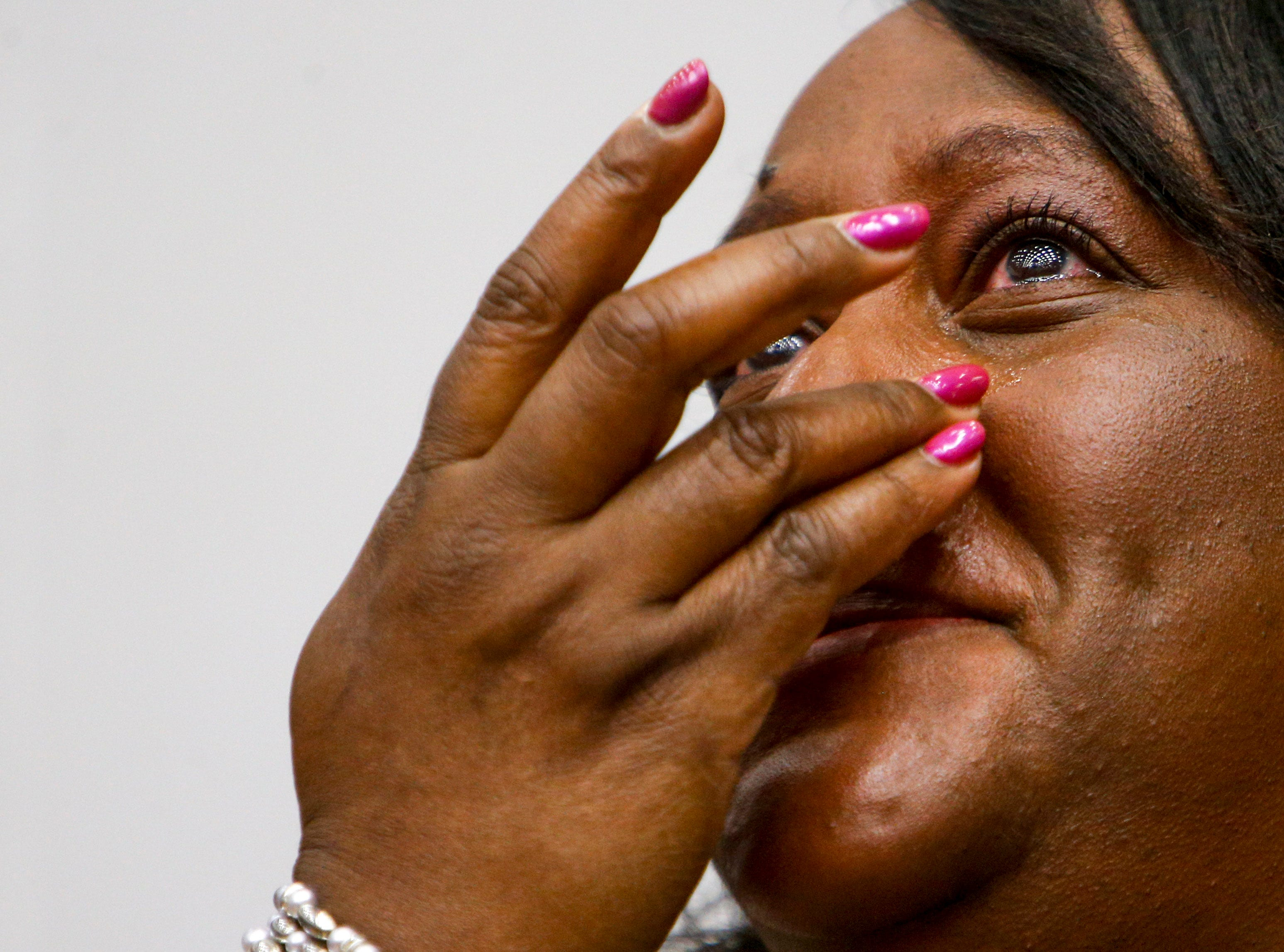Kim Morrow, who works in housing at APSU, wipes away tears as she watches some students she knows walk and receive their diplomas at the Austin Peay spring commencement ceremony 2019 for College of Business and College of STEM at Winfield Dunn Center in Clarksville, Tenn., on Friday, May 3, 2019.