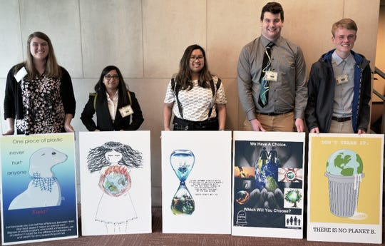 "(l-r):  Academy for Health and Medical Sciences at Somerset County Vocational & Technical High School students Evelyn Sullivan of Raritan, Mutka Patwari of Bridgewater, Gilliana Loyola of Green Brook, Kyle Amerman of Bridgewater and Robert Kramer of Branchburg (receiving for Janum Shah of Belle Mead) pose in front of their posters at the CTAUN (Committee on Teaching About the United Nations) Conference 2019 entitled, ""Global Warming."""