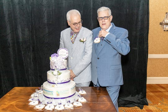 Former editor of the Courier News, Home News Tribune and MyCentralJersey.com Paul Grzella, left, with his husband, Ed Edwards, after being named the Somerset County 2019 Citizen of the Year by the Somerset County Business Partnership on Thursday, May 2.
