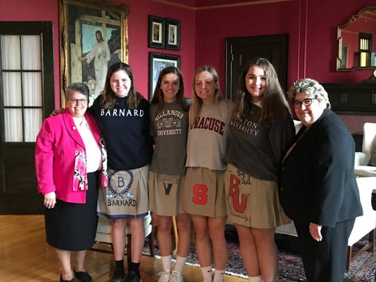 Left to right, are: Sister Lisa D. Gambacorto, RSM, Ed.S., Directress, Grace Schleck, Caroline Cull, Michaela Walsh, Erica MacDonald, and Denise Materia, Director of Athletics and Assistant Directress for Discipline and Activities.