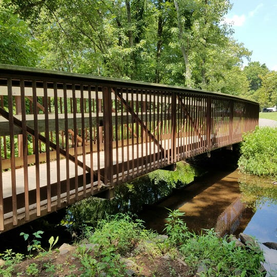 Footbridge over Mill Brook in Johnson Park, near the railroad trestle.