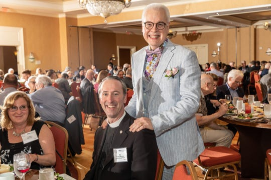 Former editor of the Courier News, Home News Tribune and MyCentralJersey.com Paul Grzella, right, with Fr. Ron Pollock of St. John's Episcopal Church, left, after being named as the Somerset County 2019 Citizen of the Year by the Somerset County Business Partnership on Thursday, May 2.