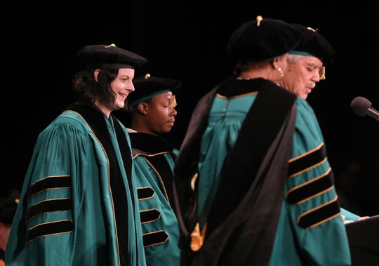 "Detroit's own Jack White is all smiles while listening to Wayne State University president M. Roy Wilson talk before White was to receive his honorary doctor of humane letters degree for ""his dedication to Detroit and significant contributions to the arts "" at the Fox Theatre in downtown Detroit on Friday, May 3, 2019."