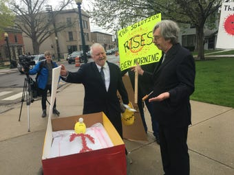 "Two-dozen environmental activists held a ""funeral"" for nuclear power in Monroe, Mich. on April 30, 2019."
