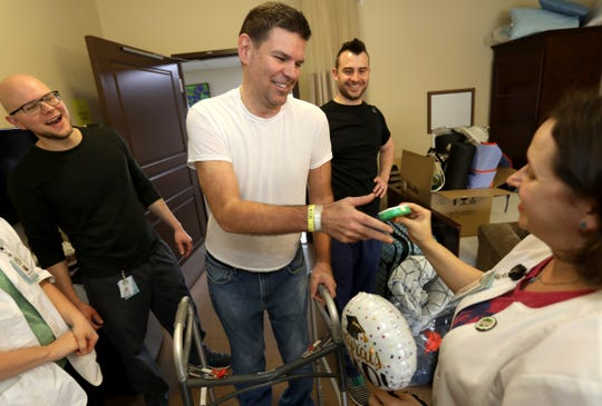 Greg Piscopink receives various gifts from some of the staff that helped take care of him since October 1, 2018 at Maple Manor Rehab Center in Novi, Michigan on Friday, April 26, 2019. Piscopink was severely injured with extensive leg and upper body injuries and broken bones in a car crash on I-75 North in Springfield Township on August 15, 2018. His son, Gregory Piscopink, a quarterback for Brother Rice was driving and fell asleep at the wheel. Later this day Piscopink walked out with the help of a walker and headed home.