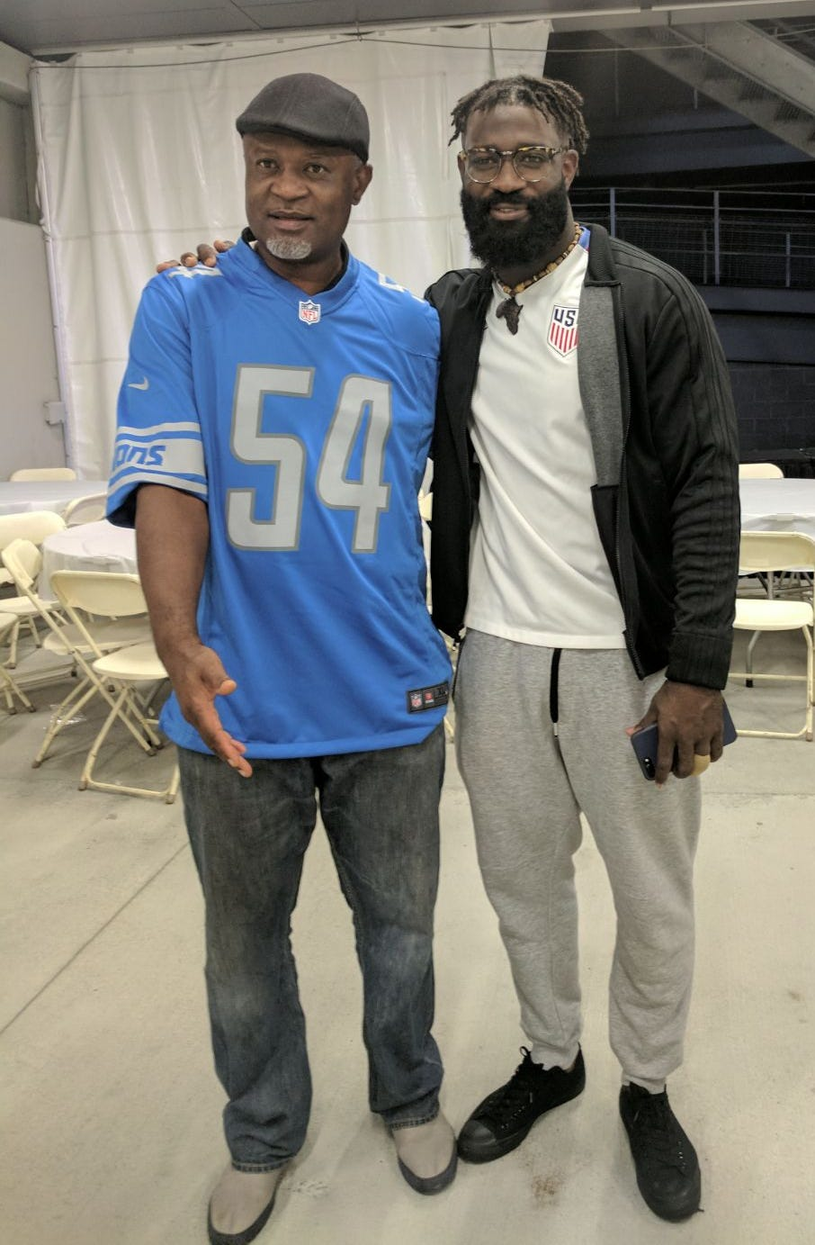 Lions linebacker Steve Longa, right, and his father.